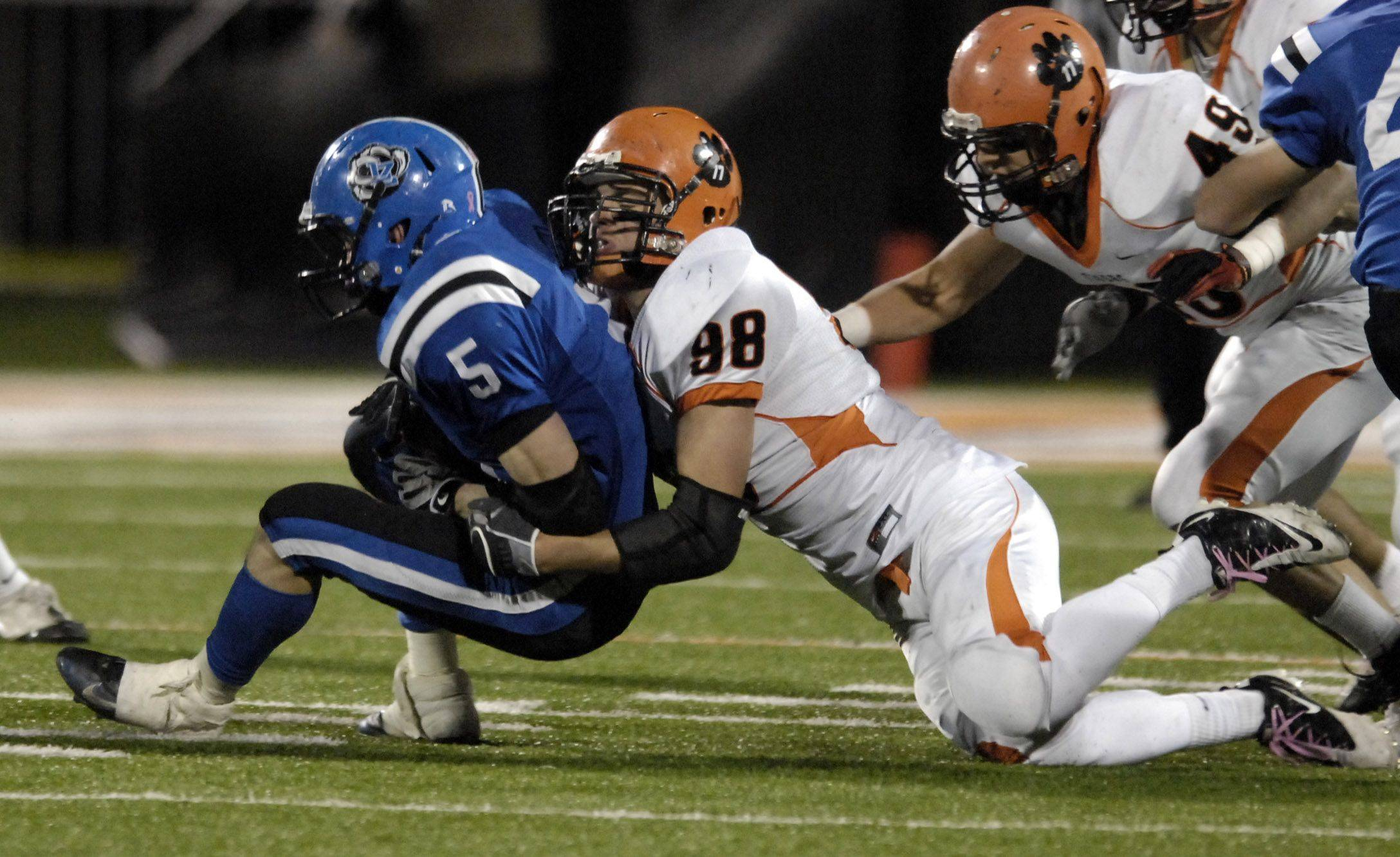 Wheaton Warrenville South's Jack Lipinsky tackles Lake Zurich's Jacob Brinlee for a loss during the Class 7A state final in Champaign Saturday.