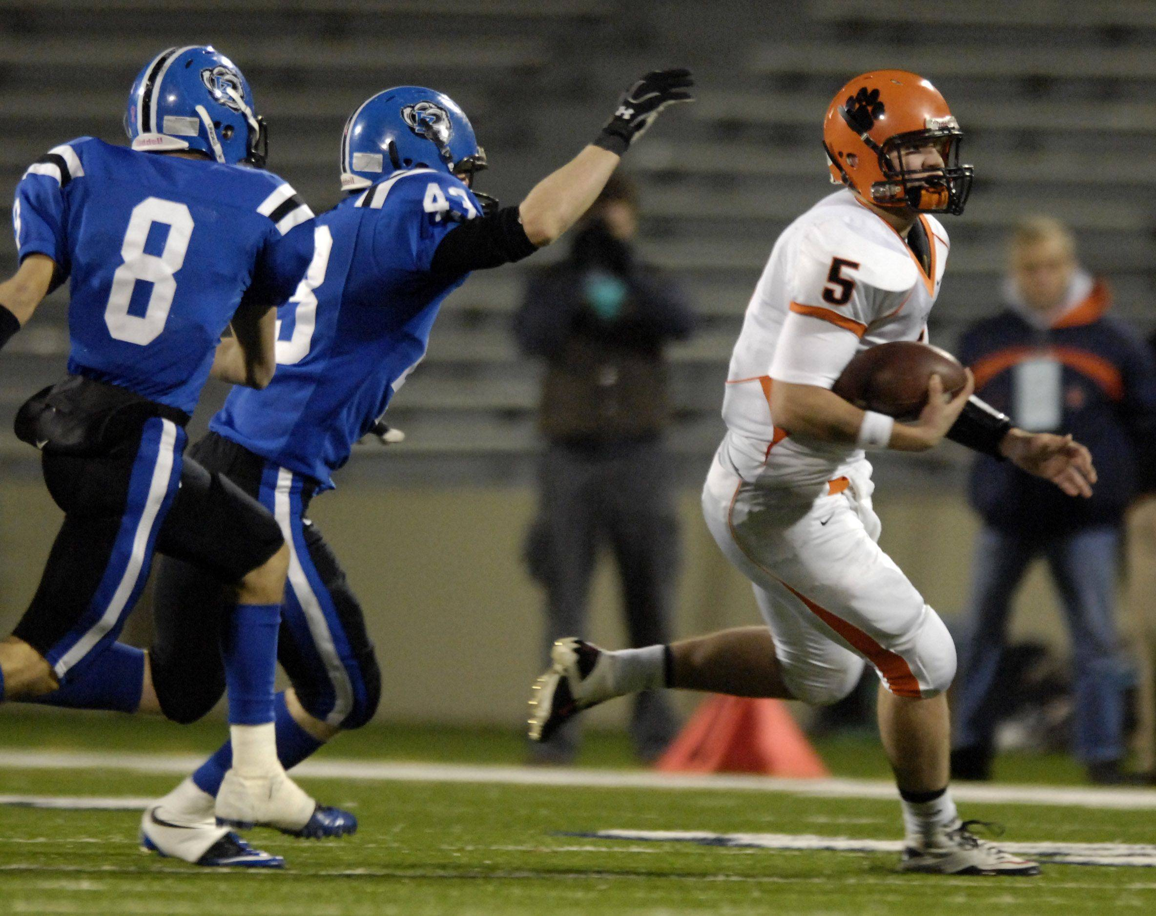 Wheaton Warrenville South quarterback Reilly O'Toole escapes the rush and takes it outside against Lake Zurich during the Class 7A state final in Champaign Saturday.