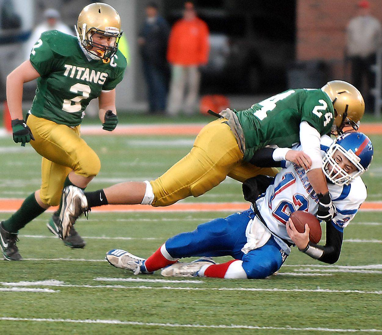Marmion's Bobby Peters is sacked by Rockford Boylan's Matt Ventimiglia during the Class 6A state final in Champaign Saturday.
