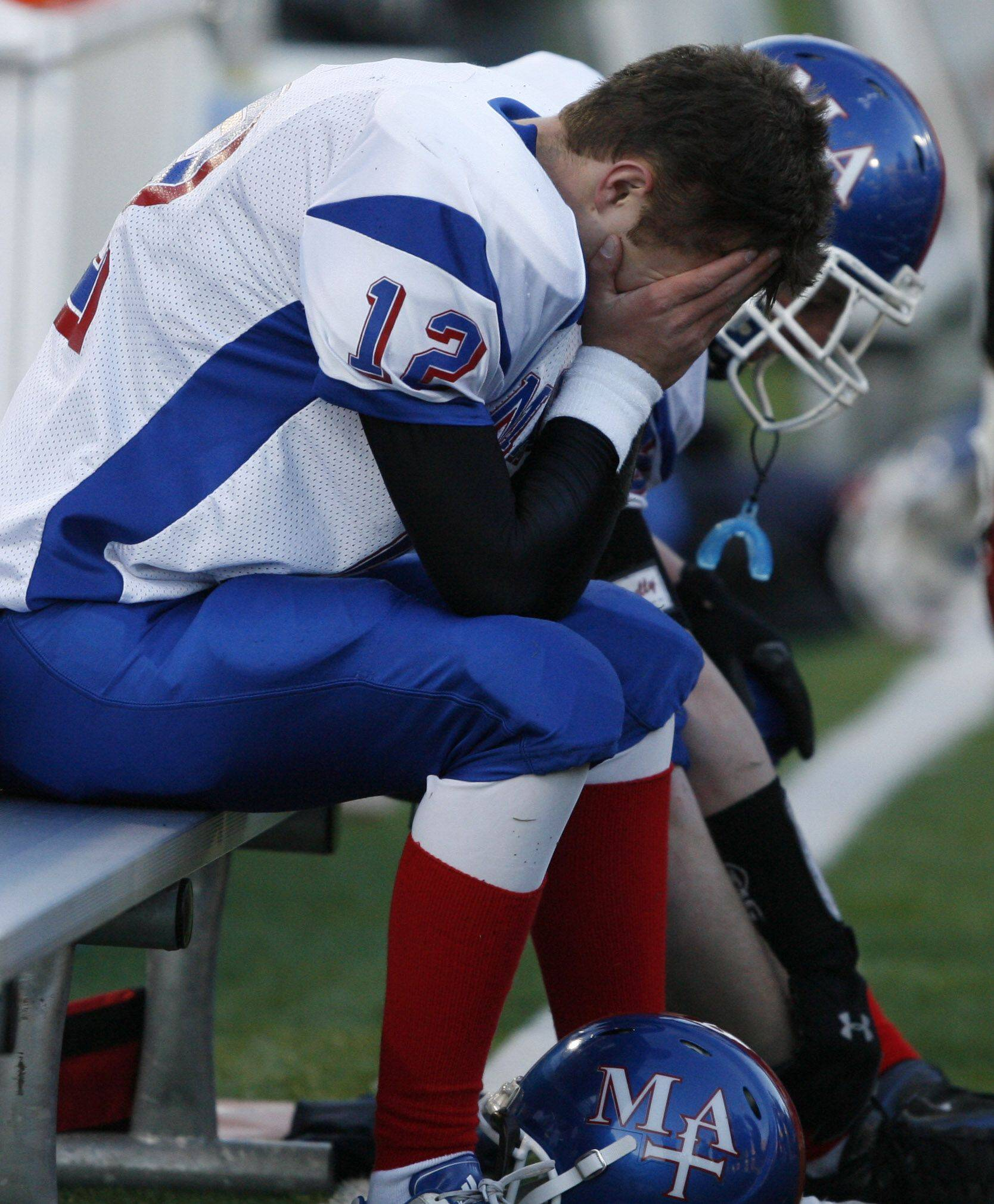 Marmion Academy's Bobby Peters can't look up at the score with seconds left on the game clock losing 48-19 to Rockford Boylan in 6A state title game in Champaign on Saturday, November 27.
