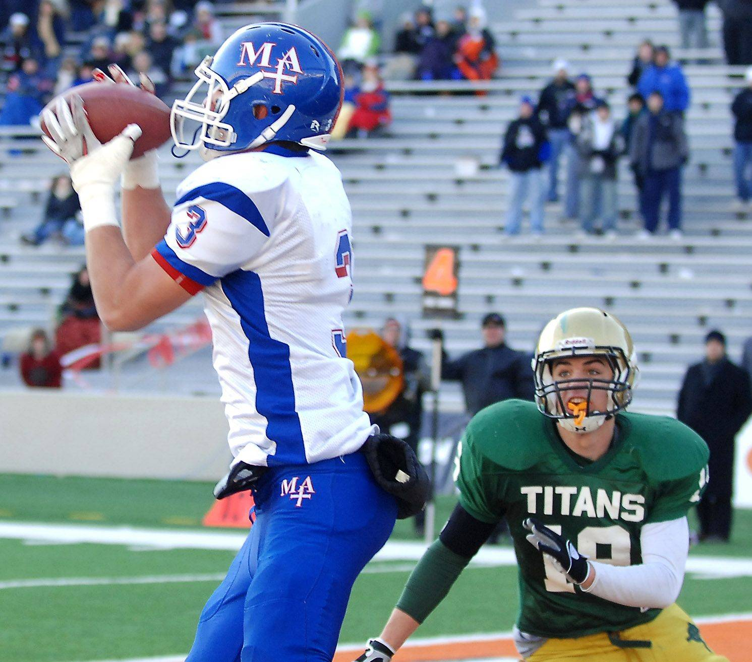 Marmion's Nick Scoliere hauls in a second-quarter touchdown catch in front of Rockford Boylan's Sam James during the Class 6A state final in Champaign Saturday.