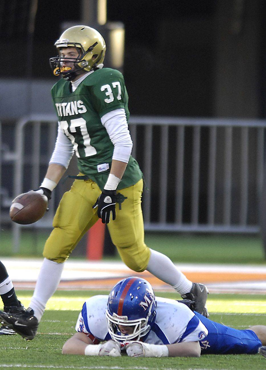 Marmion's Nick Scoliere lies on the ground after fumbling a punt and losing the ball to Rockford Boylan's Grant Flodin during the Class 6A state final in Champaign Saturday.