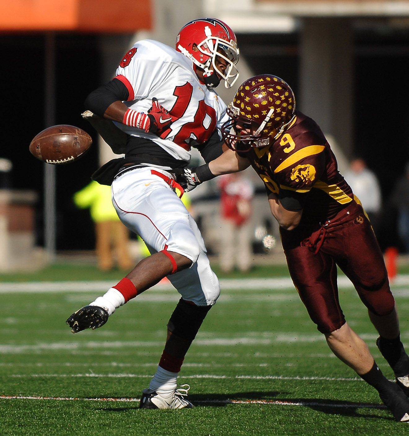 Montini's Dan Smego forces one of several first half Chatham Glenwood fumbles, this one by Raz Harris, during the Class 5A state championsip in Champaign Saturday.