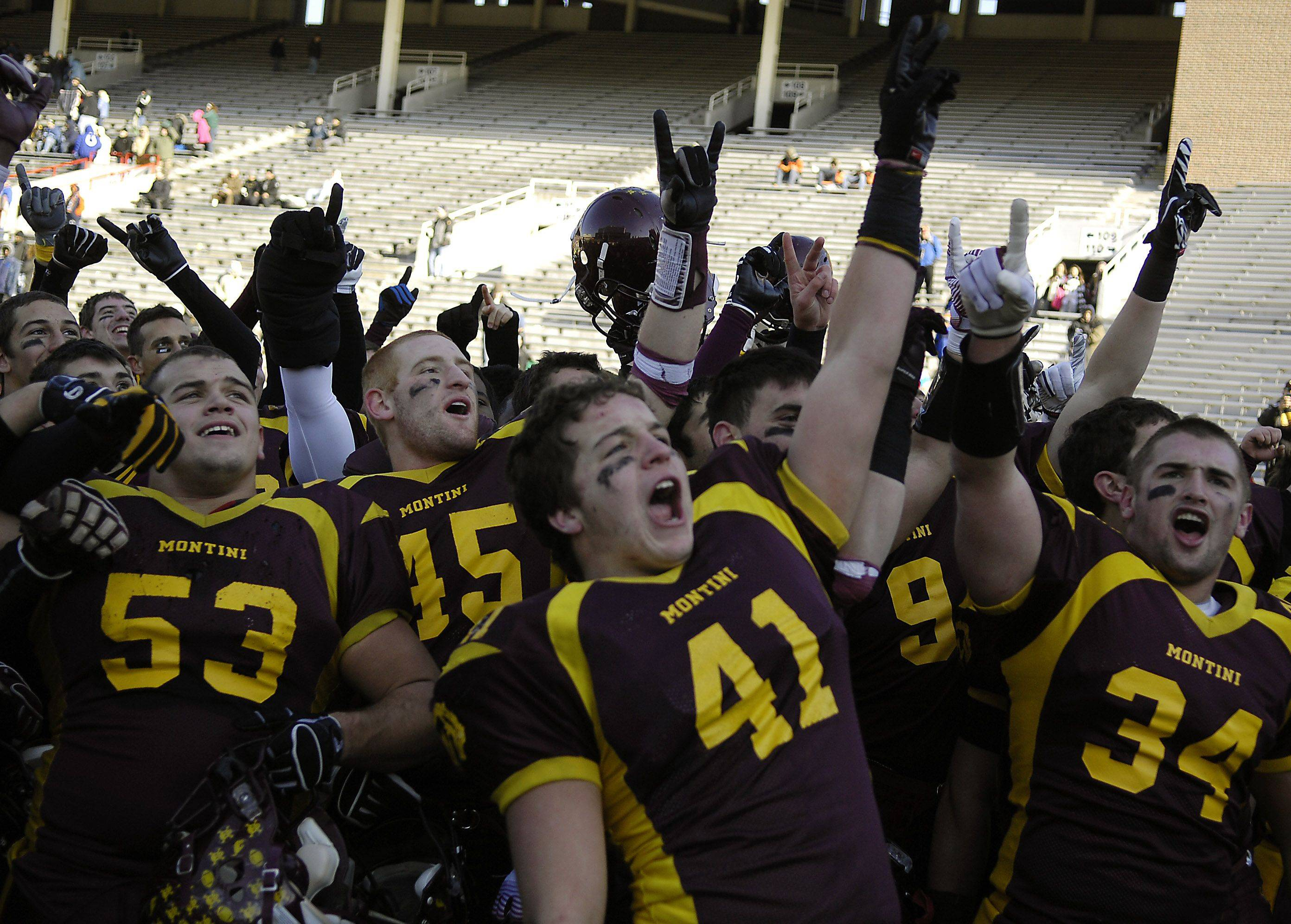 Montini players, including Zech Tredenick (41) salute their fans following their win over Chatham Glenwood during the Class 5A state championsip in Champaign Saturday.