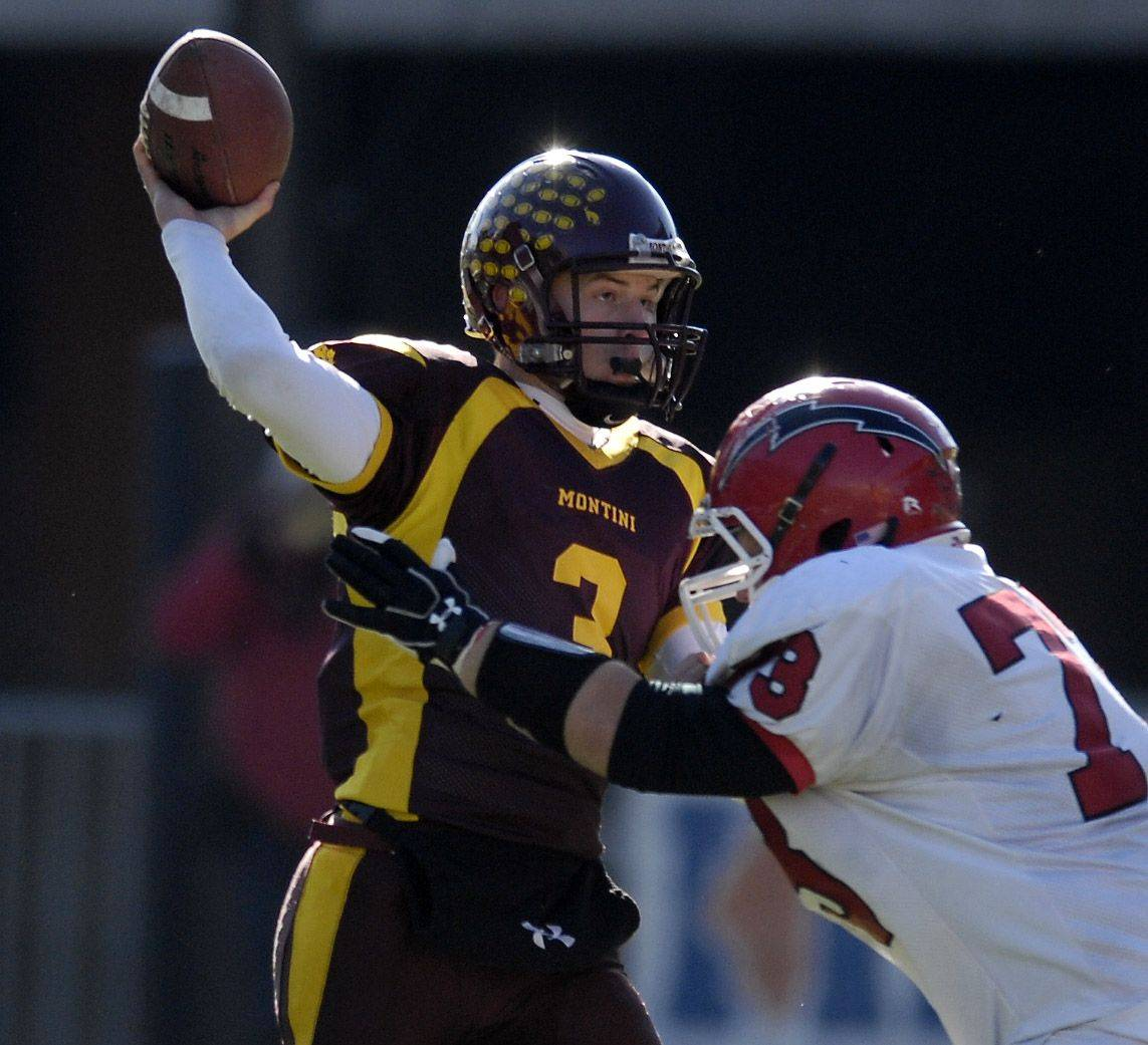 Montini quarterback Matt Westerkamp throws while under pressure from Chatham Glenwood's Henry Holgun during the Class 5A state championsip in Champaign Saturday.