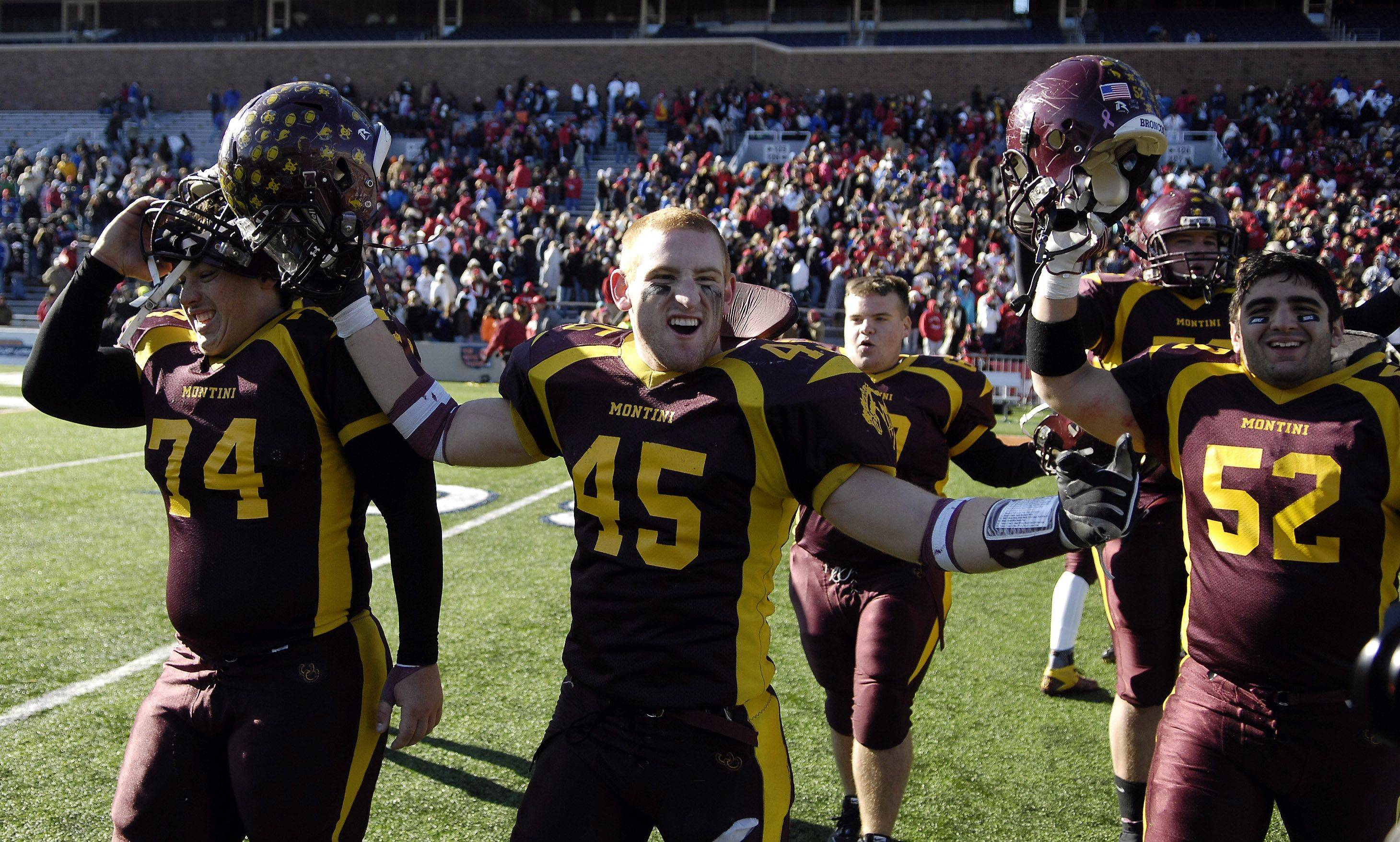 Montini's Alex Walters and teammates celebrate their win over Chatham Glenwood during the Class 5A state championsip in Champaign Saturday.