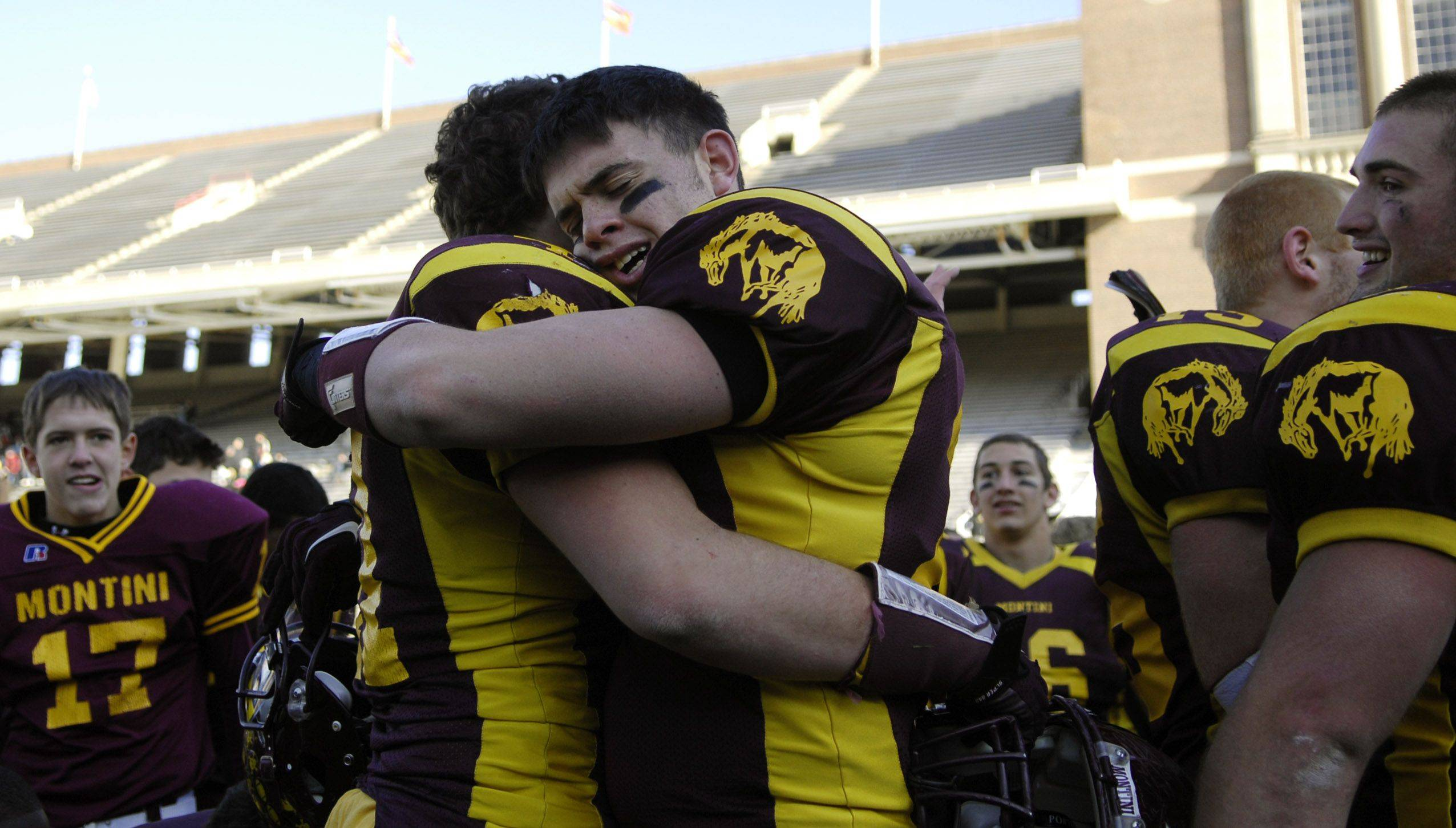 Montini's Anthony Damato, right, and Zech Tredenick hug after their win over Chatham Glenwood during the Class 5A state championsip in Champaign Saturday.