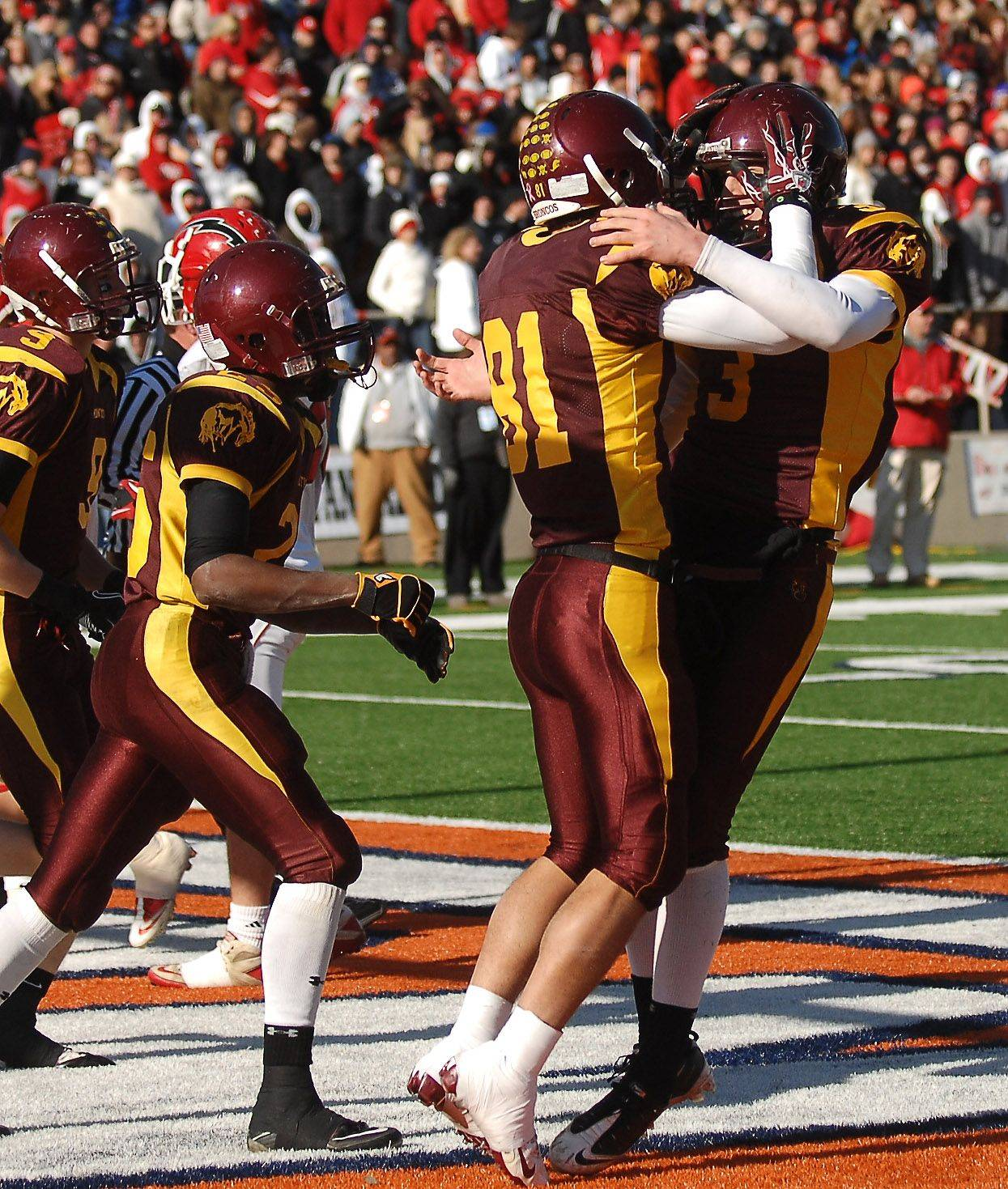 Montini quarterback Matt Westerkamp celebrates with Jordan Westerkamp after they hooked up for their first touchdown pass and catch against Chatham Glenwood during the Class 5A state championsip in Champaign Saturday.
