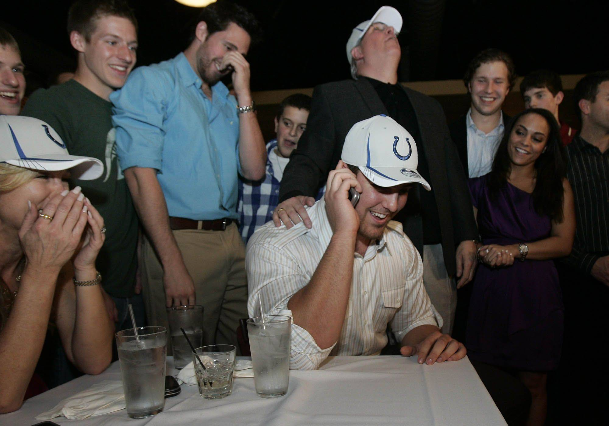 Anthony Castonzo dons a Colts caps after being selected by Indianapolis in the first round of the NFL draft Thursday night.