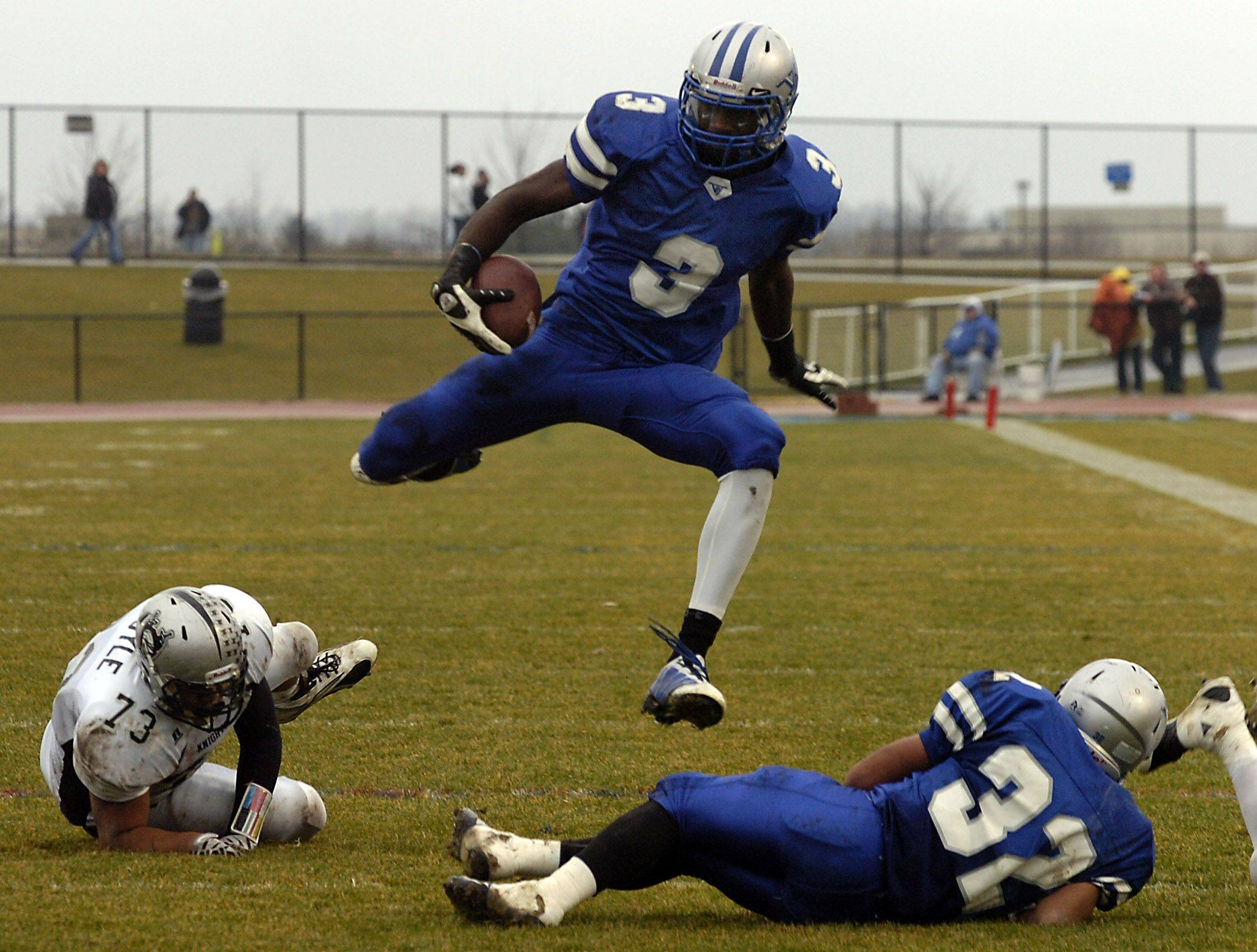 DaVaris Daniels goes airborne as he sheds Kaneland's Jimmy Boyle for yardage in the Class 5A football quarterfinals.