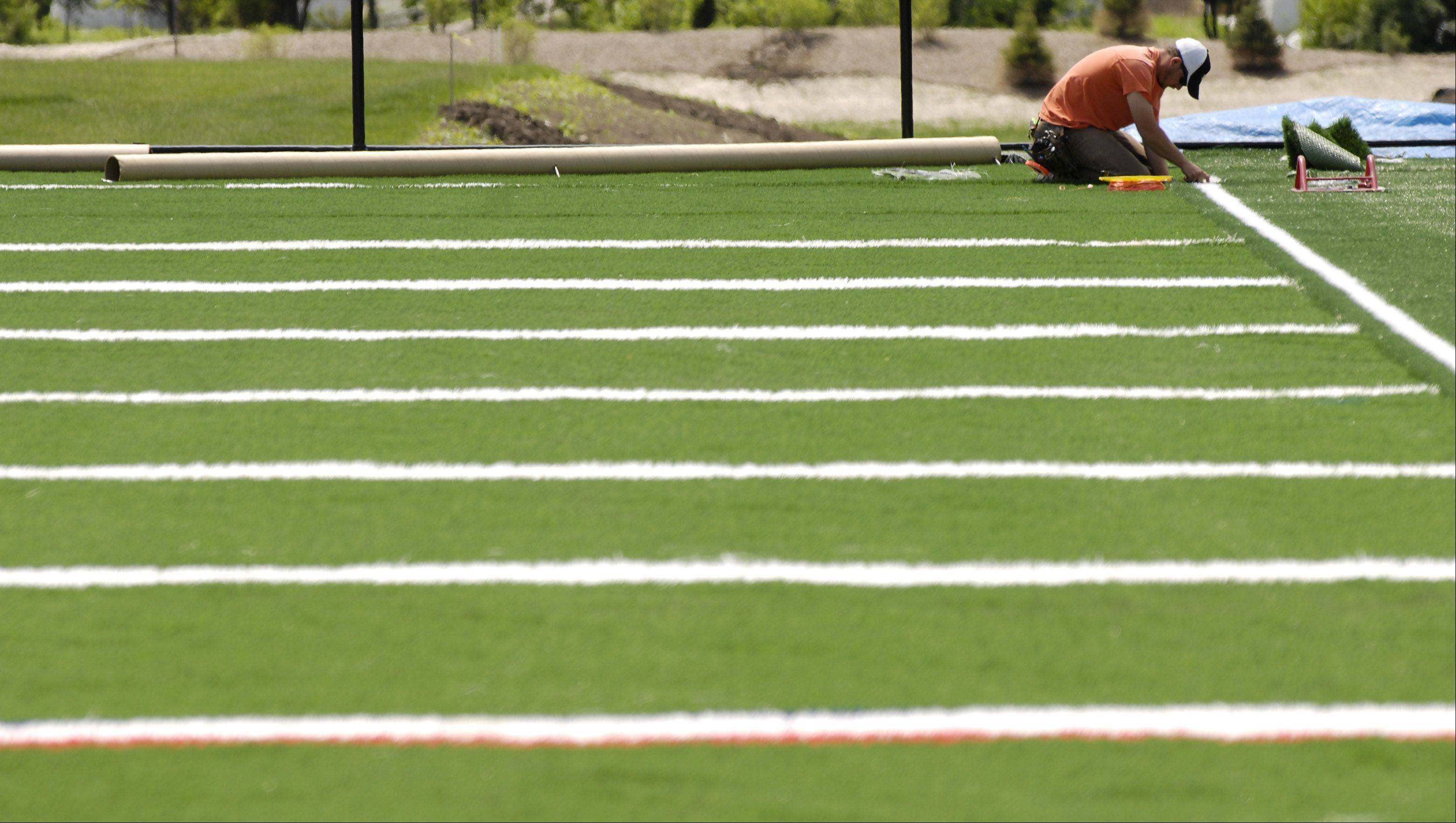 More suburban schools turning to artificial turf