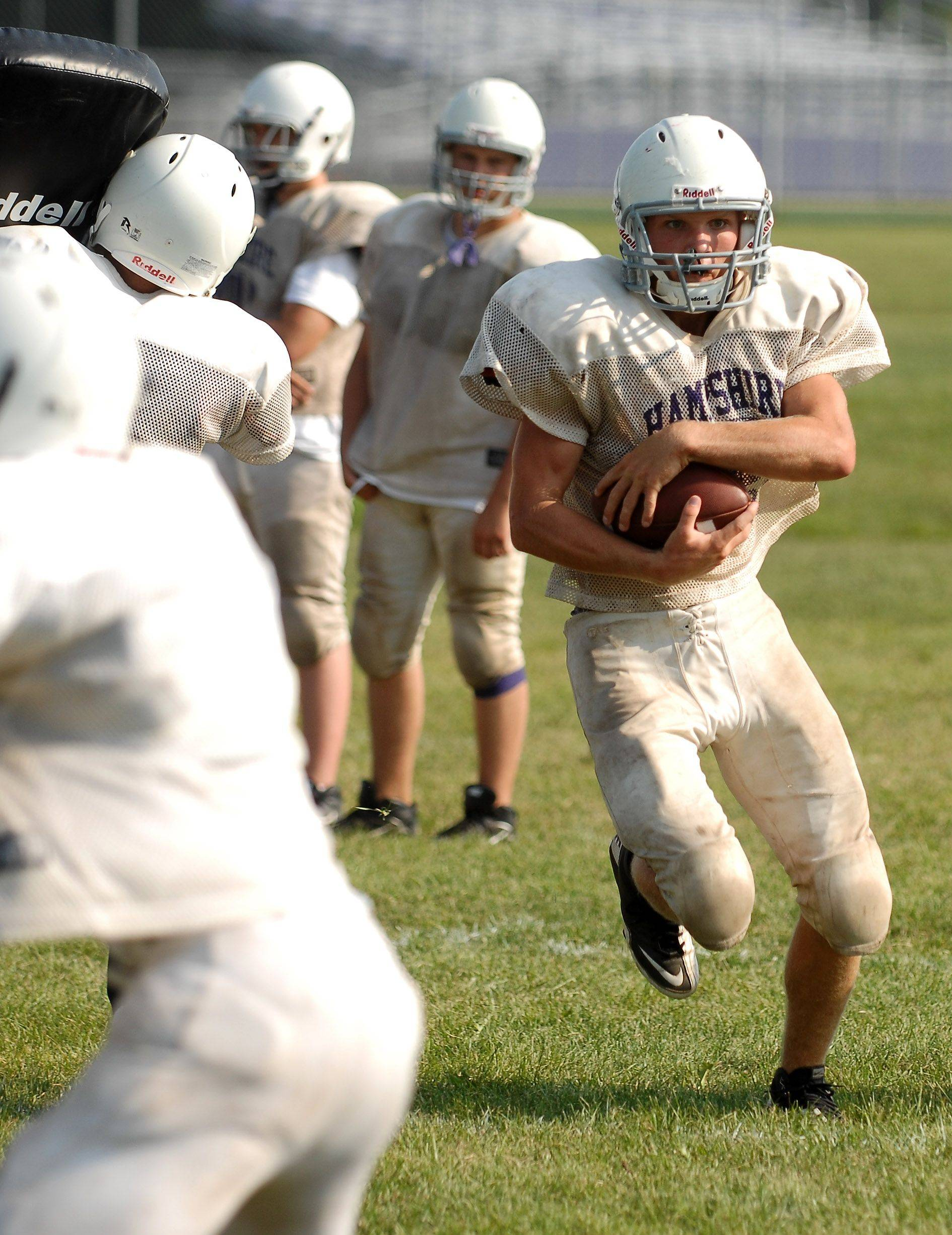 Chase Lundy finds some running room during a Hampshire football practice last week. The Whip-Purs join the Fox Division of the Fox Valley Conference this season for the first time. They open the season Friday at home against traditional rival Burlington Central.