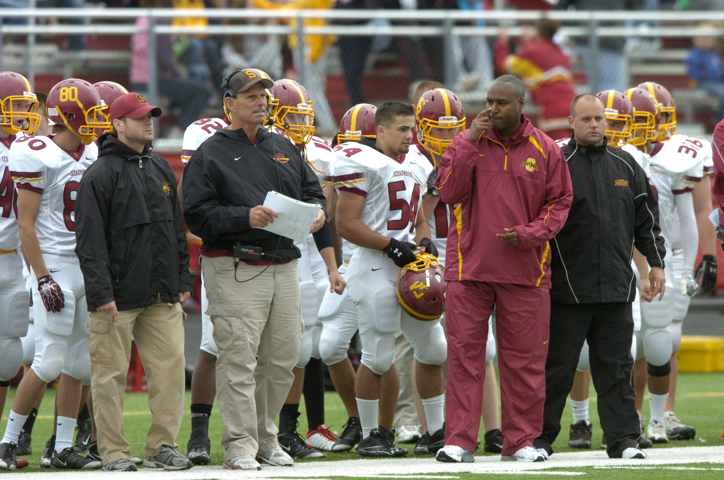 Schaumburg's coaching staff during last year's game at Barrington.