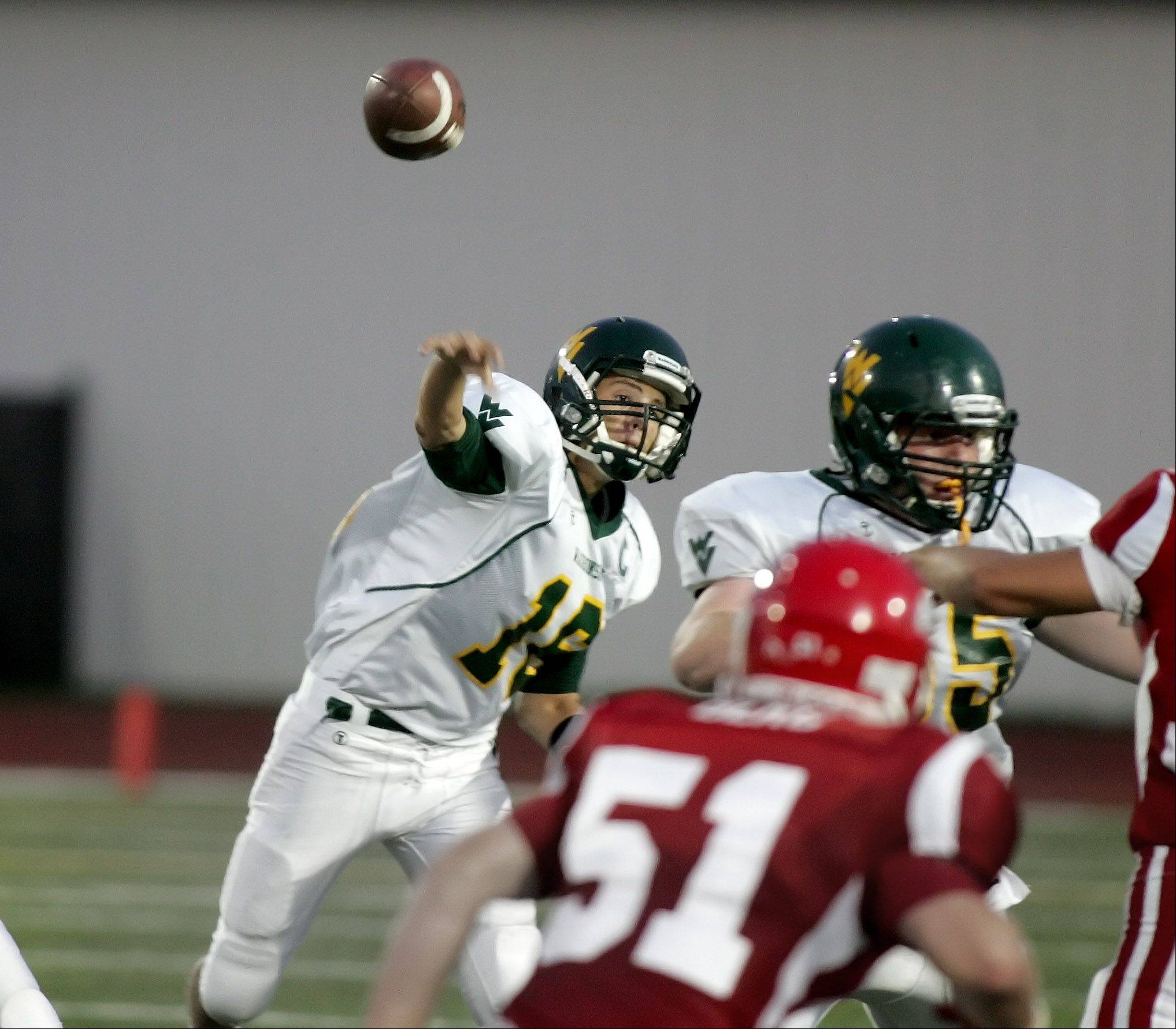 Waubonsie Valley quarterback Mitch Stefani throws a pass against Naperville Central in football action Friday in Naperville.