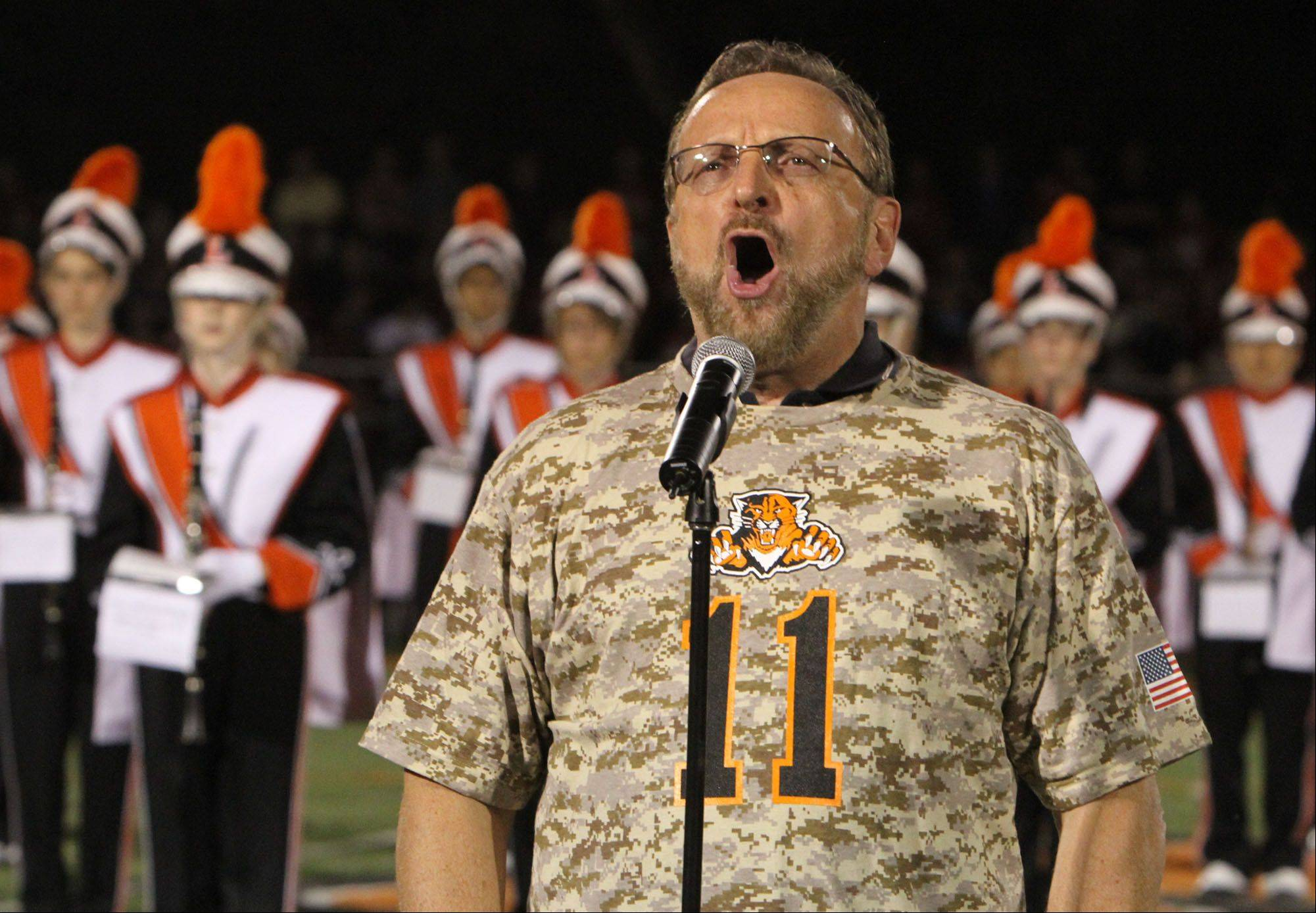 Wayne Messmer sings the national anthem during military appreciation night as Libertyville battles Barrington at Libertyville on Friday, August 26th.