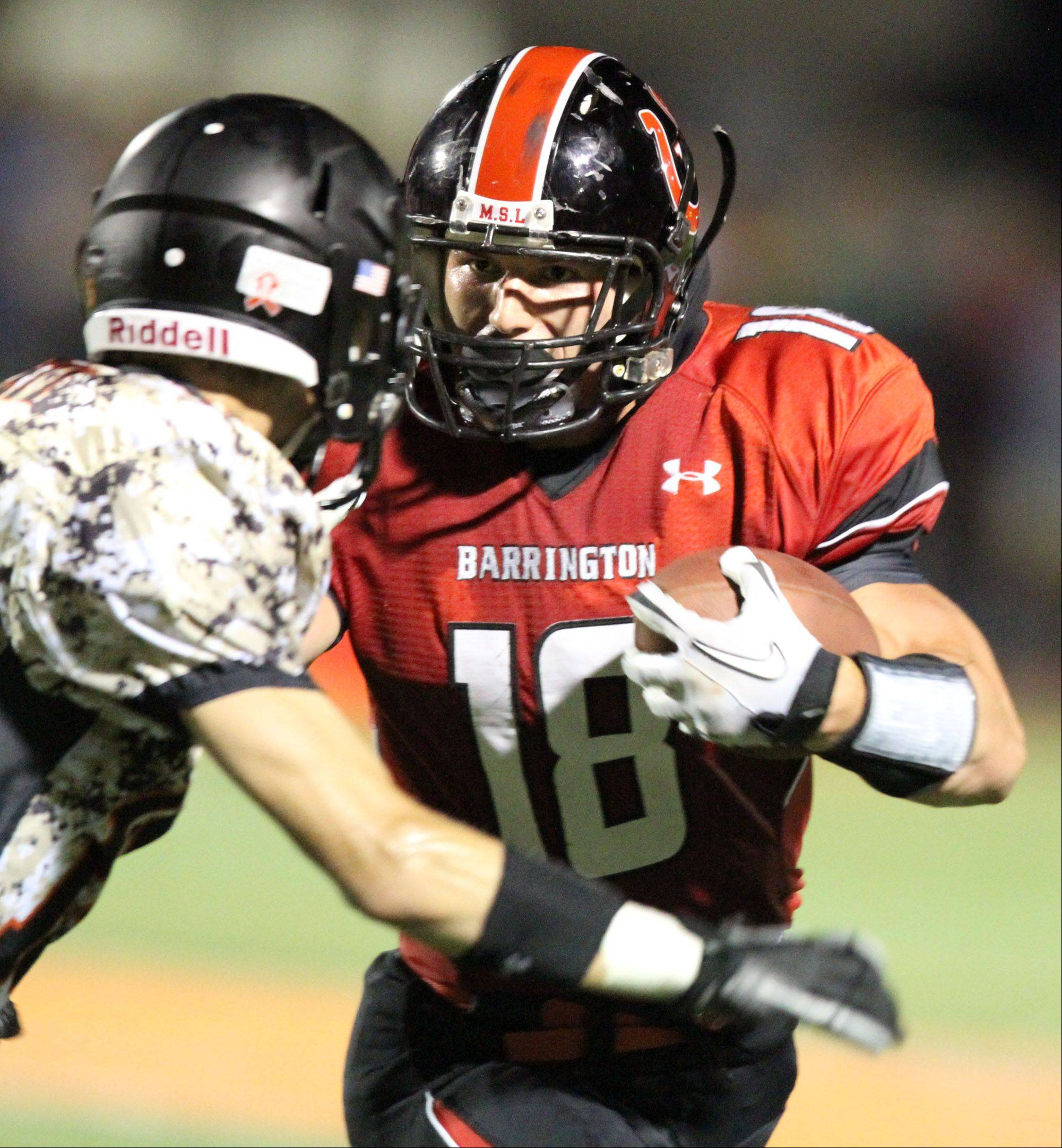 Barrington's Chase Murdock runs the ball at Libertyville on Friday, August 26th.