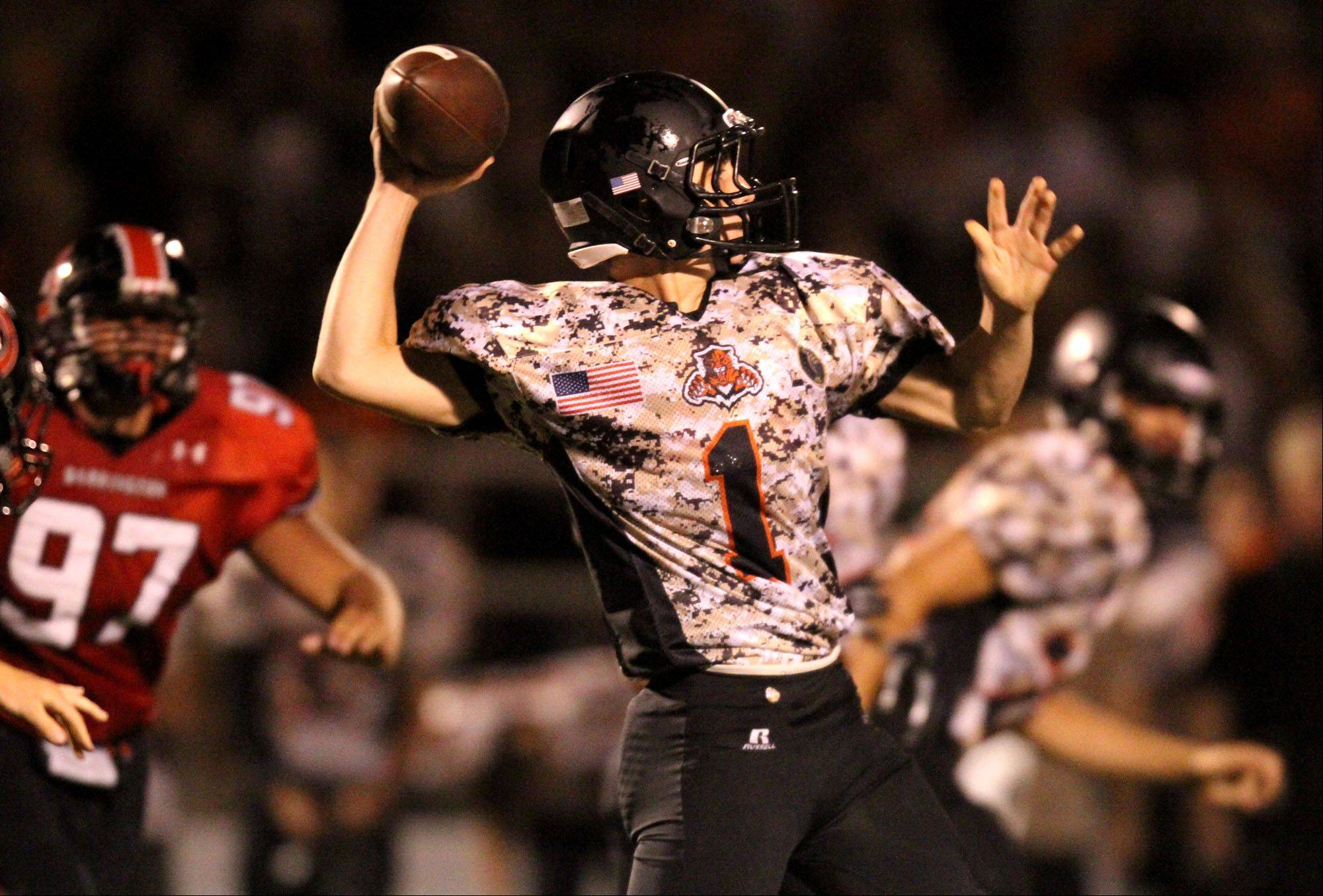 Libertyville quarterback Hutch Herchenbach passes against Barrington at Libertyville on Friday, August 26th.