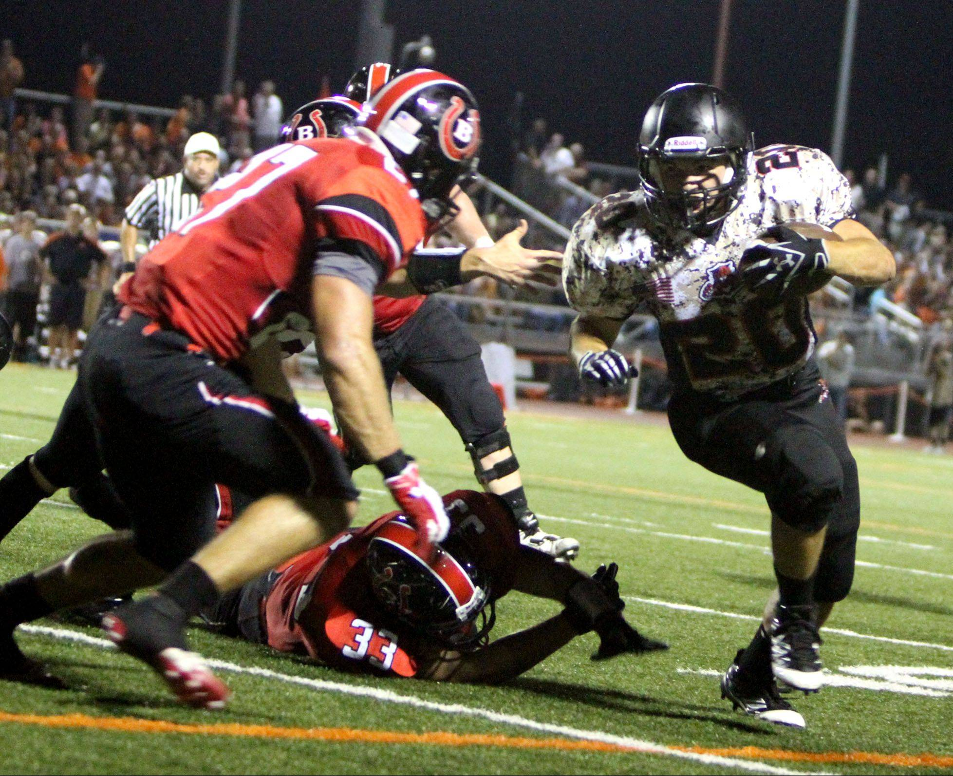 Libertyville's Brian Swift turns the corner against Barrington defenders on Friday night.