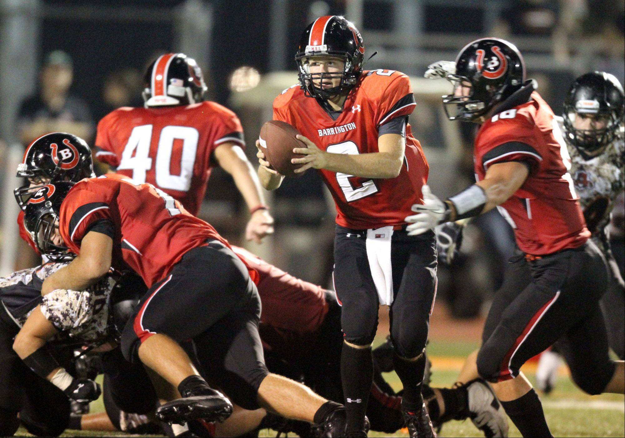 Barrington's quarterback Mark Bennett fakes a handoff to Chase Murdock at Libertyville on Friday, August 26th.