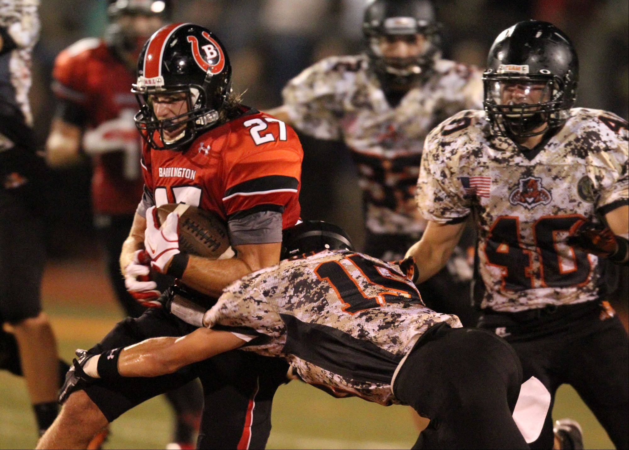 Barrington's Sam Handler is pulled down by Libertyville defender AJ Schmidt at Libertyville on Friday, August 26th.