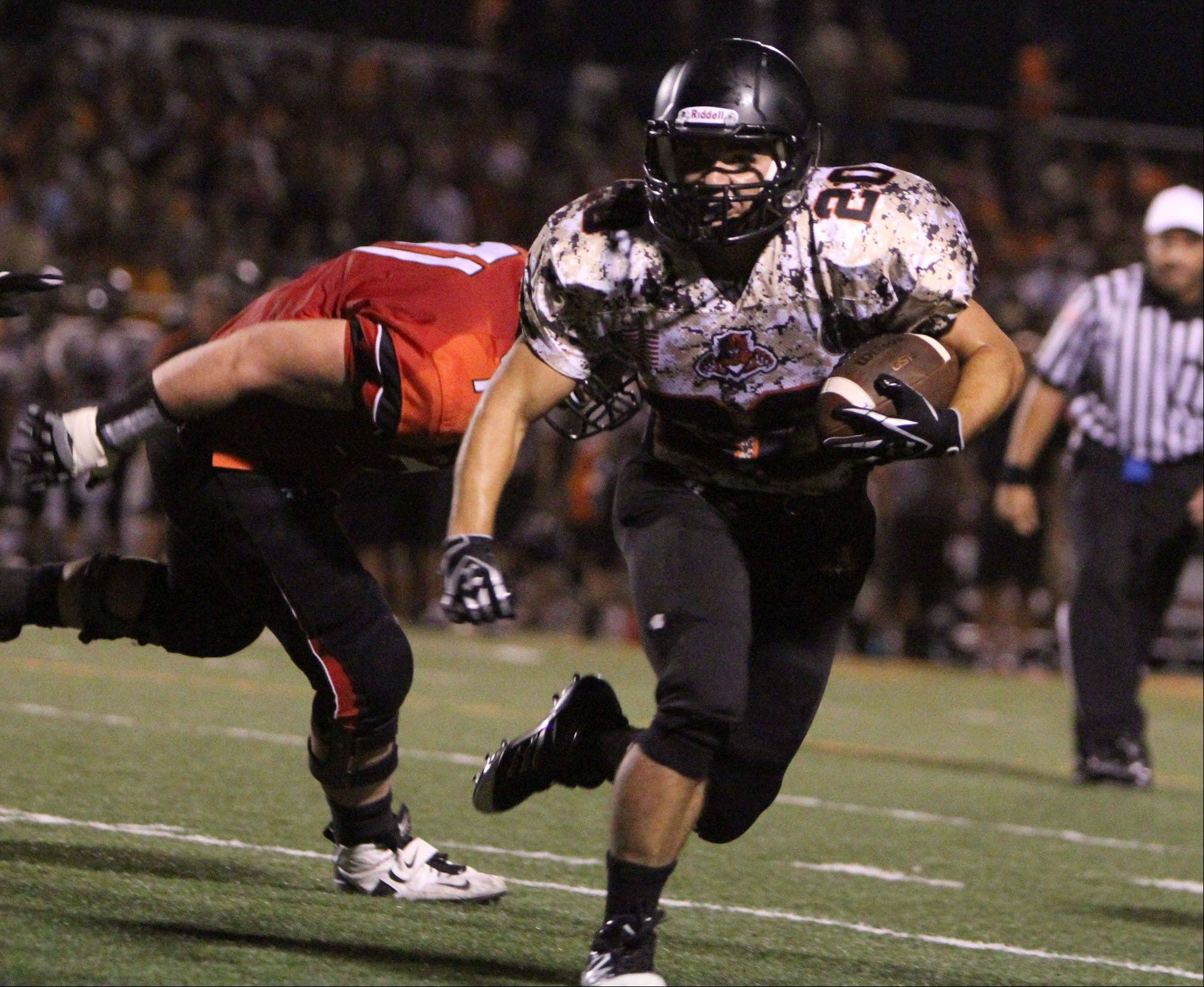 Libertyville's Brian Swift runs the ball against Barrington at Libertyville on Friday, August 26th.