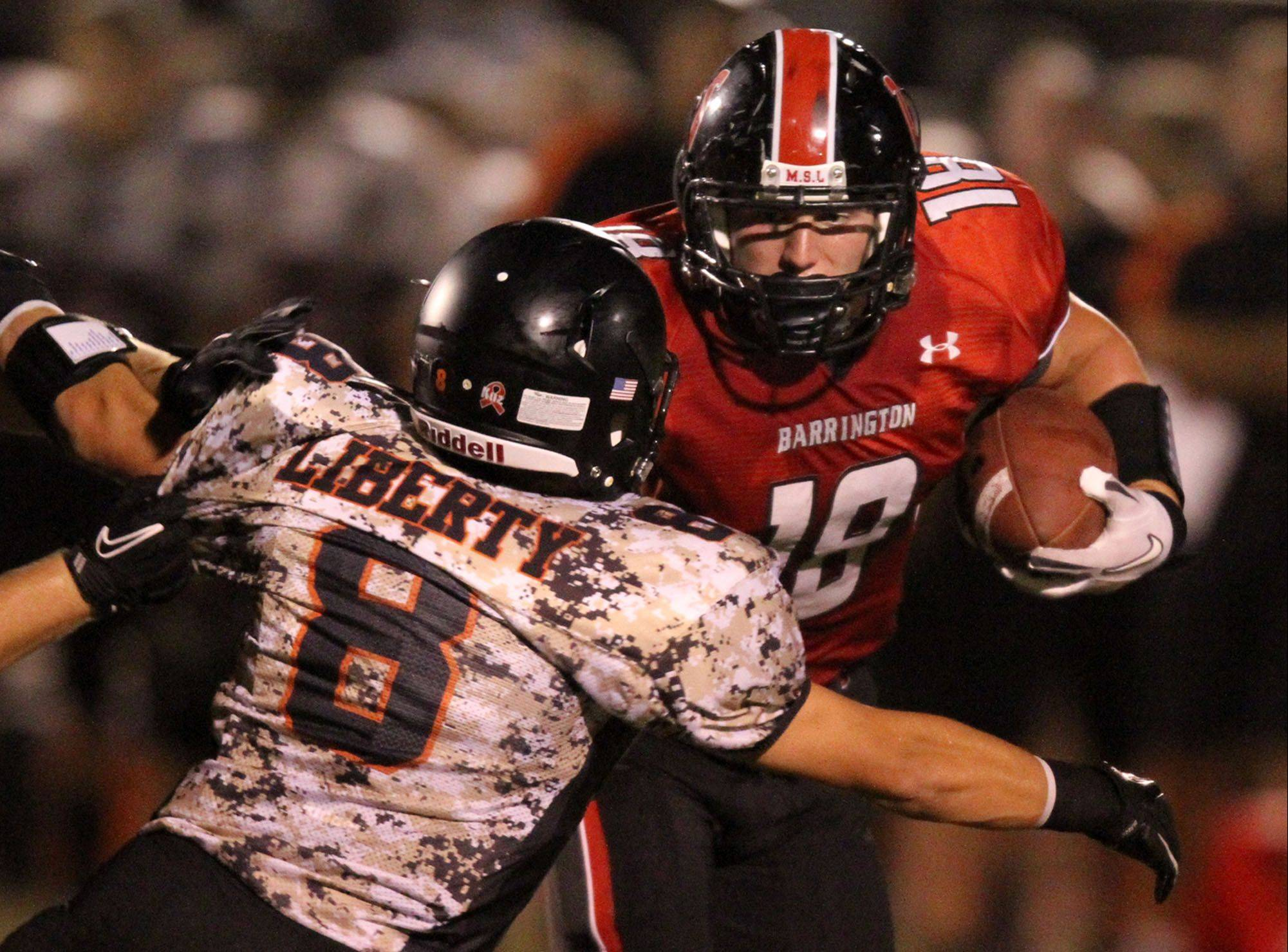 Barrington's Chase Murdock for a route past Wildcats defender Joey Salata at Libertyville on Friday.