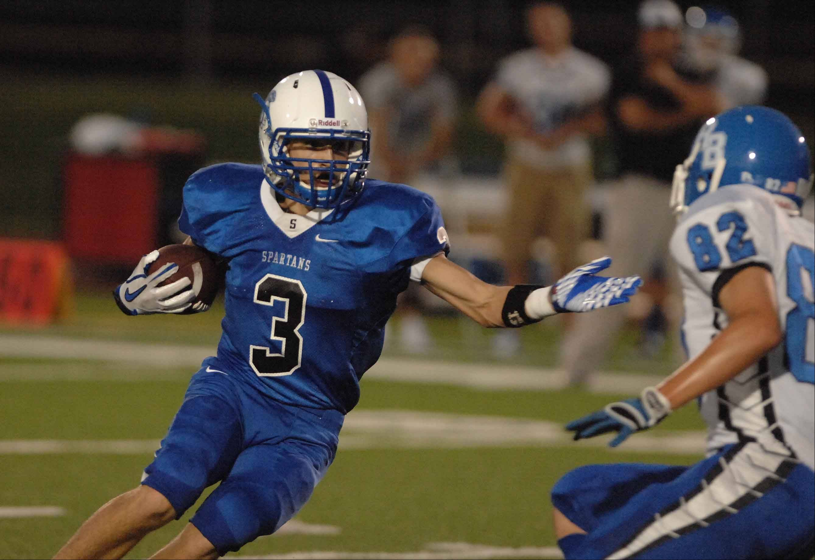 Week 1- Dan Beck of St. Francis moves the ball against Riverside-Brookfield.