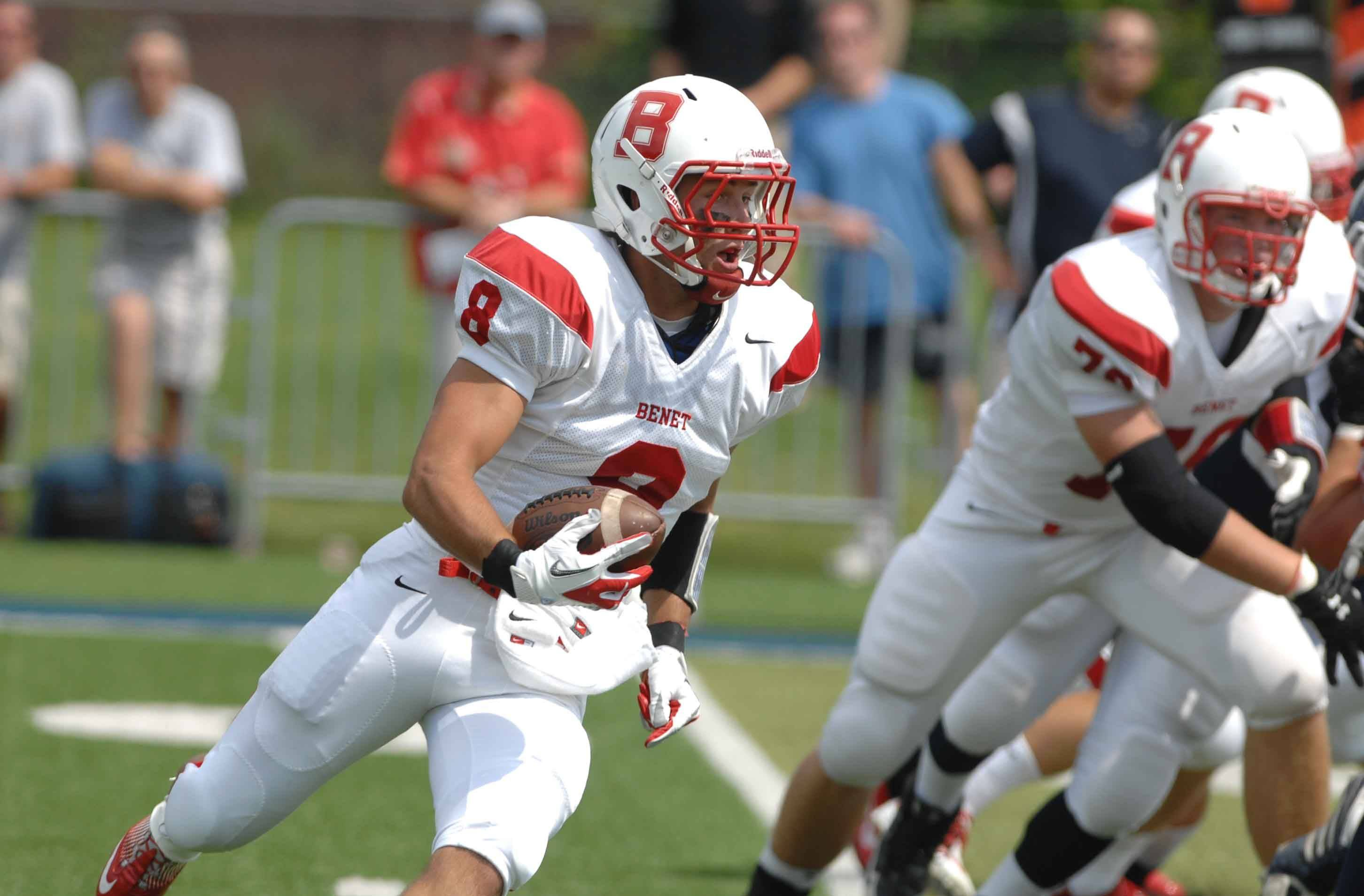 Steve Cahill ofBenet runs the ball during the Benet at Nazareth football Saturday in LaGrange Park.