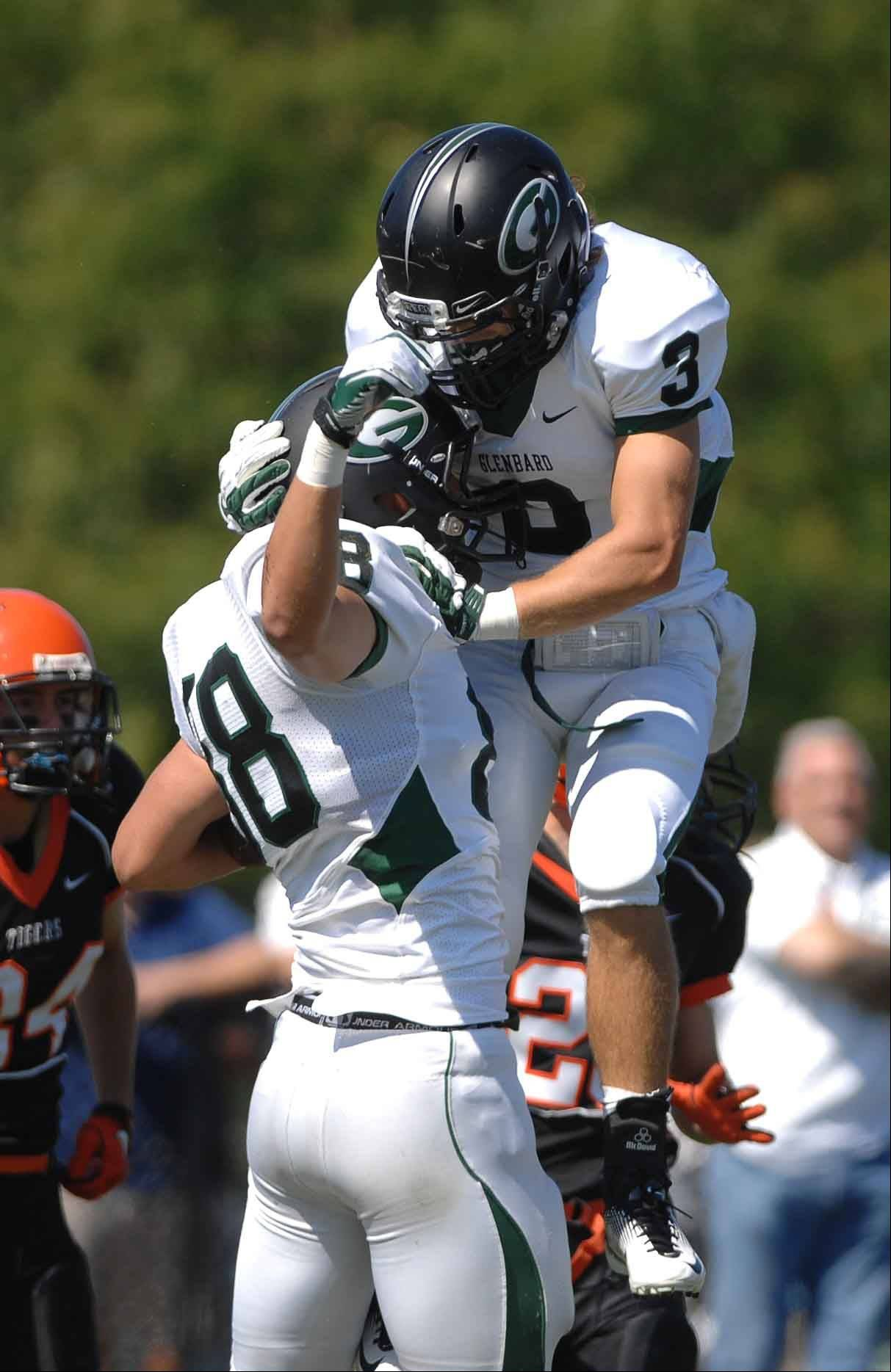 Max Bruere, left, and Avery Balogh of Glen Ellyn celebrate after a TD at Red Grange Field.