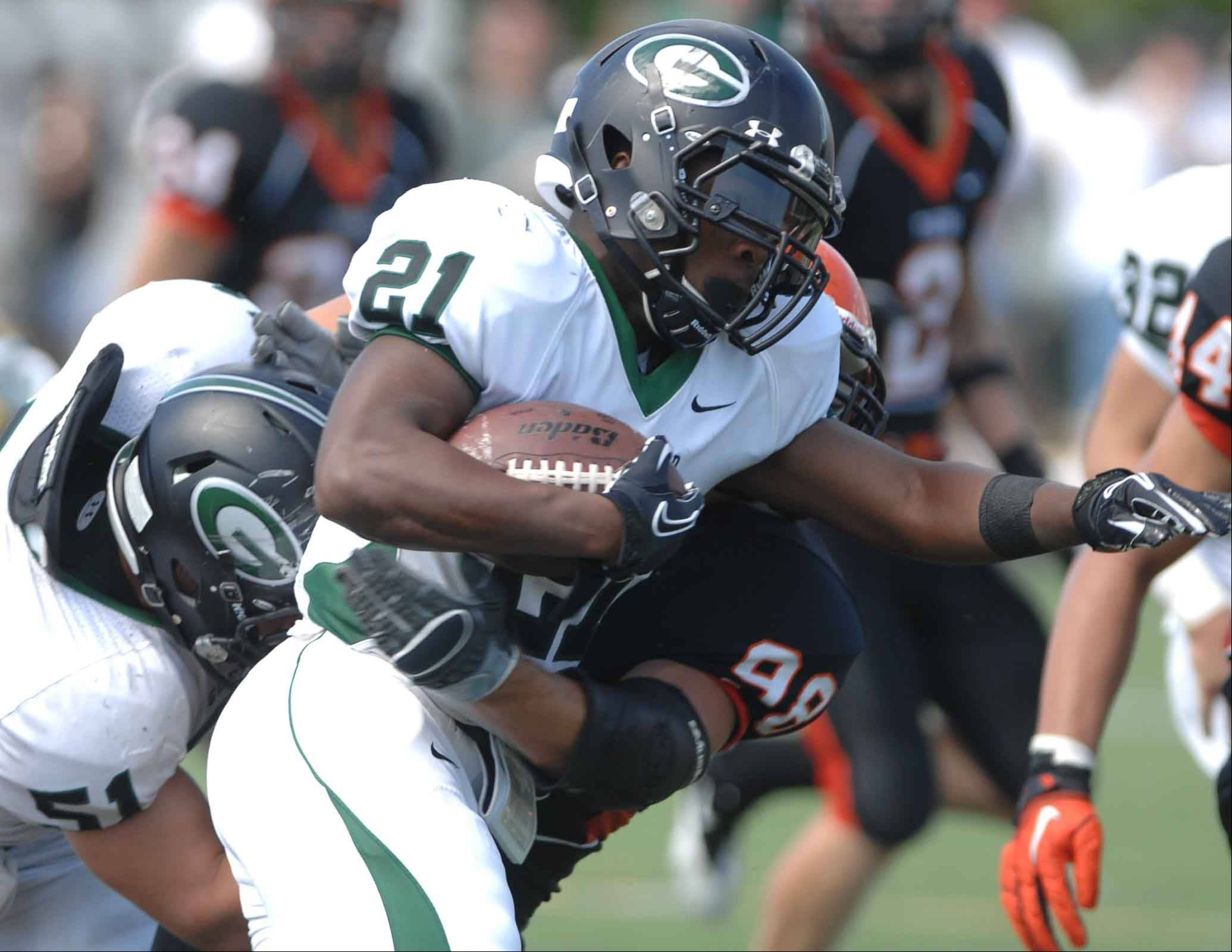Deon Dumas of Glen Ellyn moves the ball during the Glenbard West and Wheaton Warrenville South game Sunday.