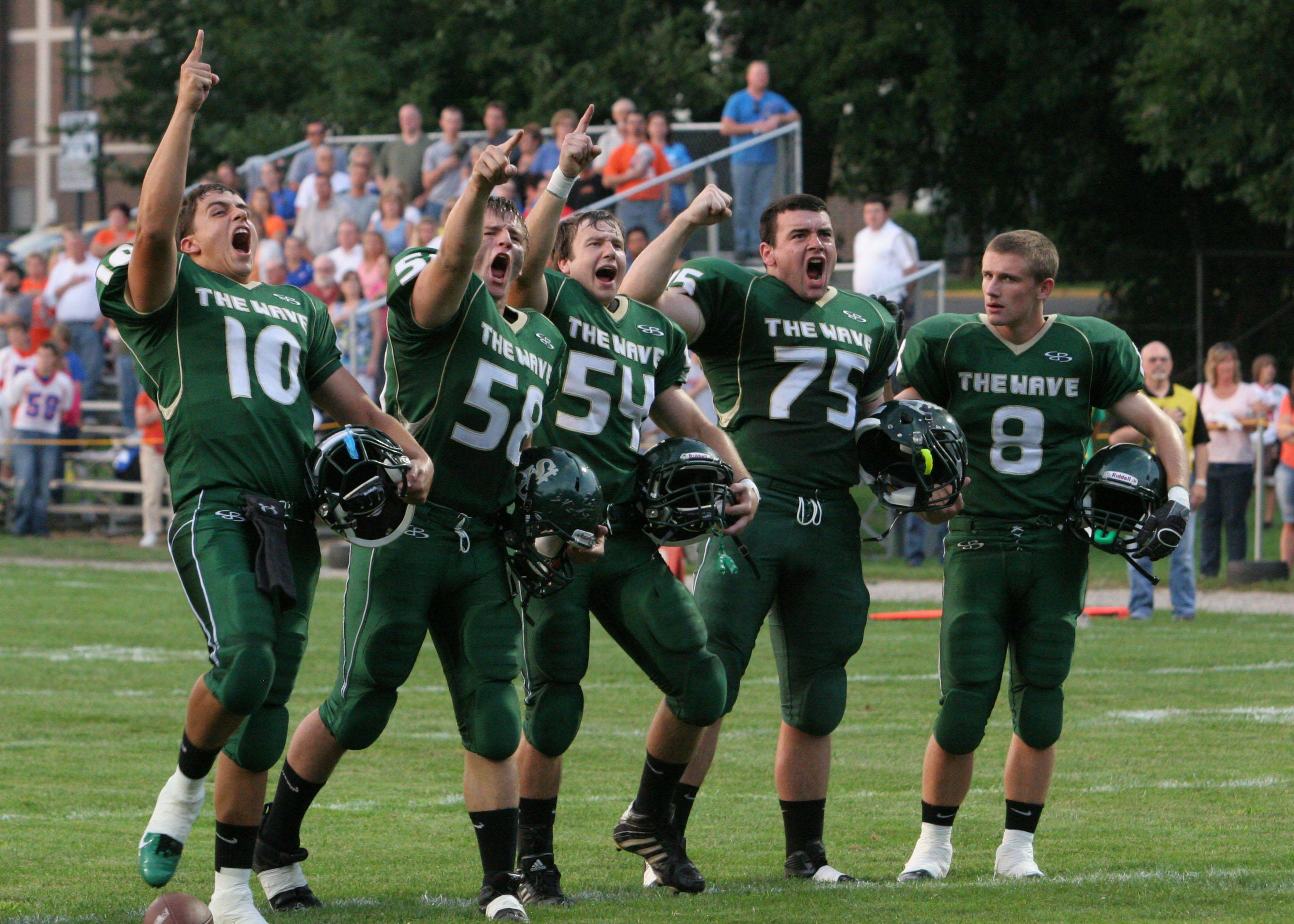 Images from St. Edward vs. Genoa-Kingston football at Greg True Field in Elgin on Friday, Aug. 26, 2011.