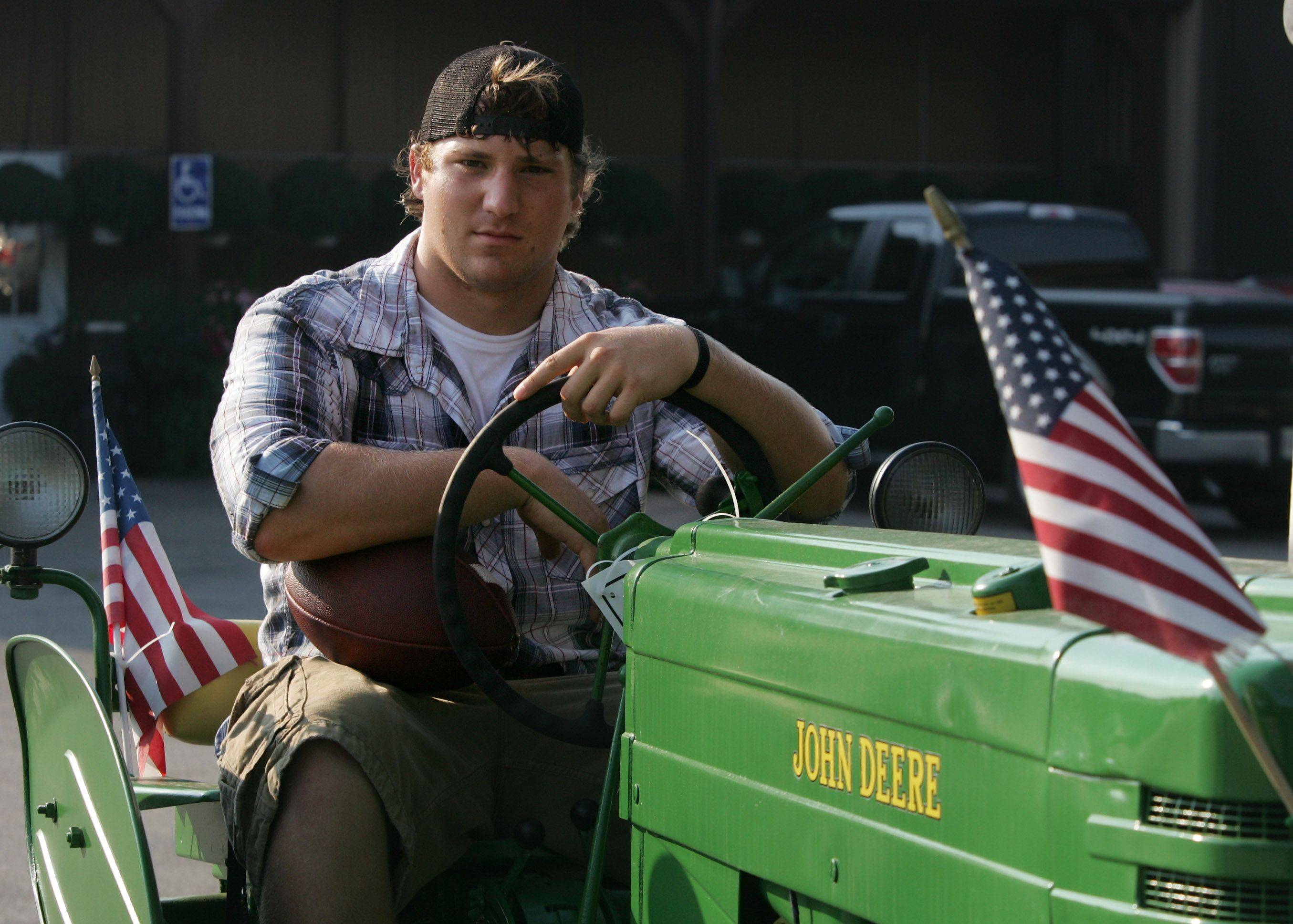 Vernon Hills High School football player Wayne Didier has roots in farming where his family owns Didier Farms in Lincolnshire.