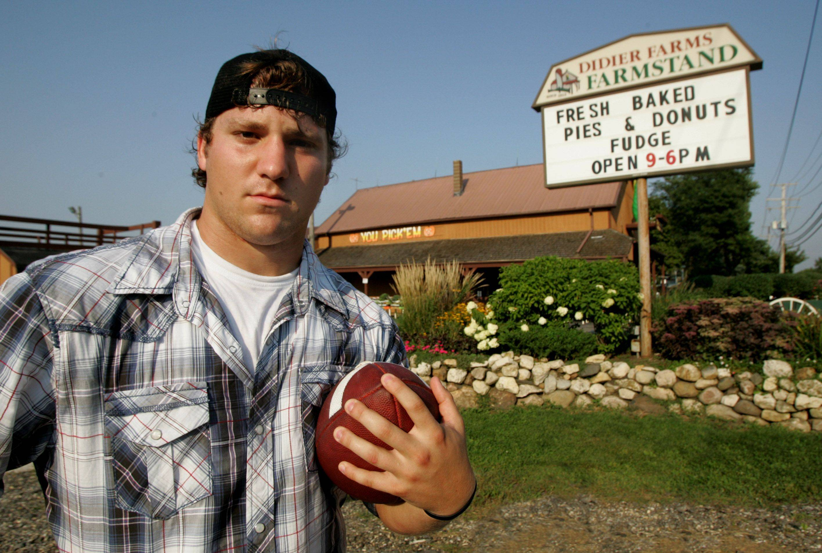 Gilbert R. Boucher II/gboucher@dailyherald.com Vernon Hills High School football player Wayne Didier has roots in farming where his family owns Didier Farms in Lincolnshire.