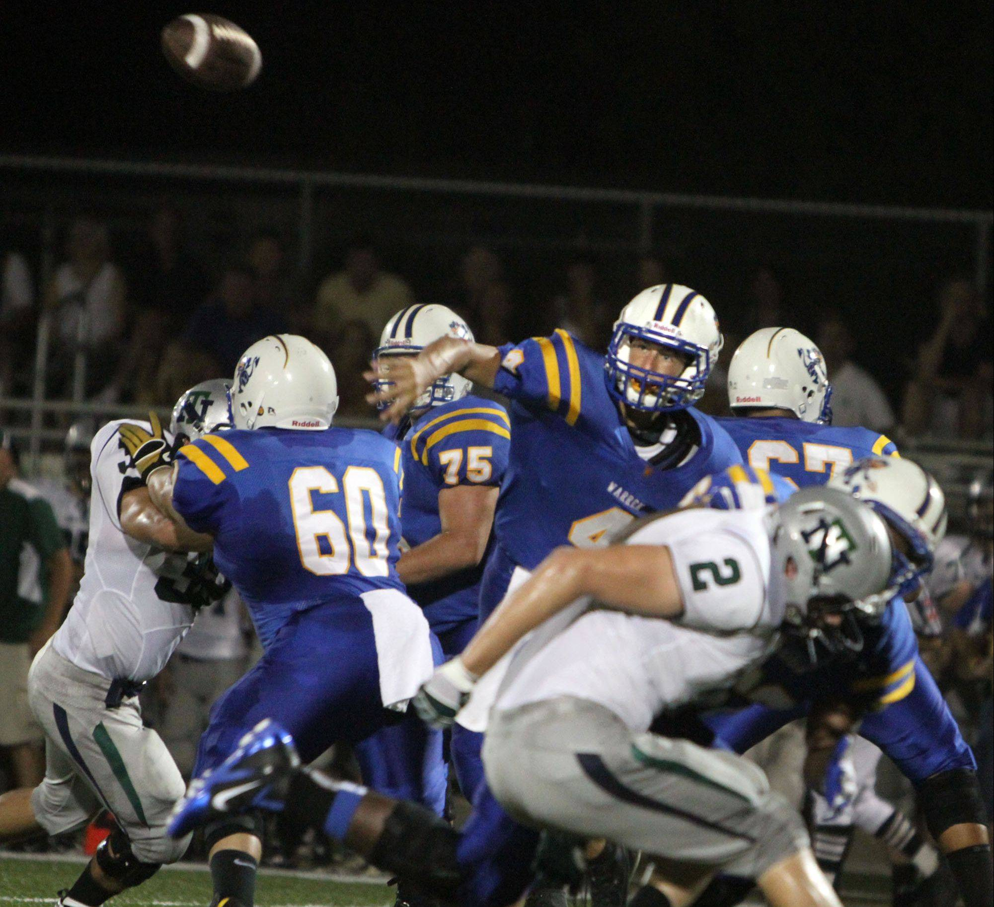 Warren's quarterback Adam Reuss finds a passing lane on Friday against visiting New Trier.