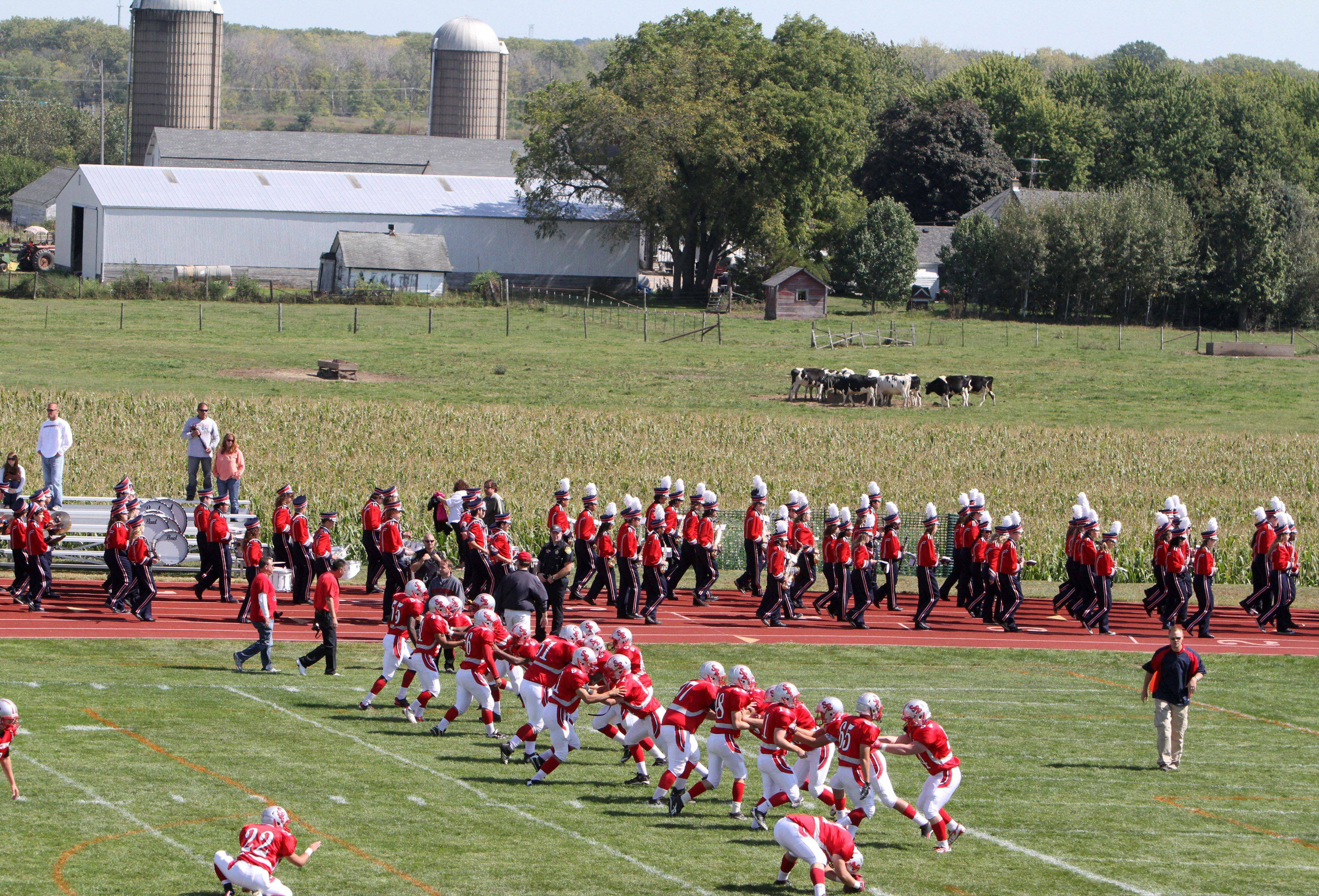 South Elgin's varsity football team and marching band prepare to play Metea Valley at the new South Elgin Booster Stadium Saturday.