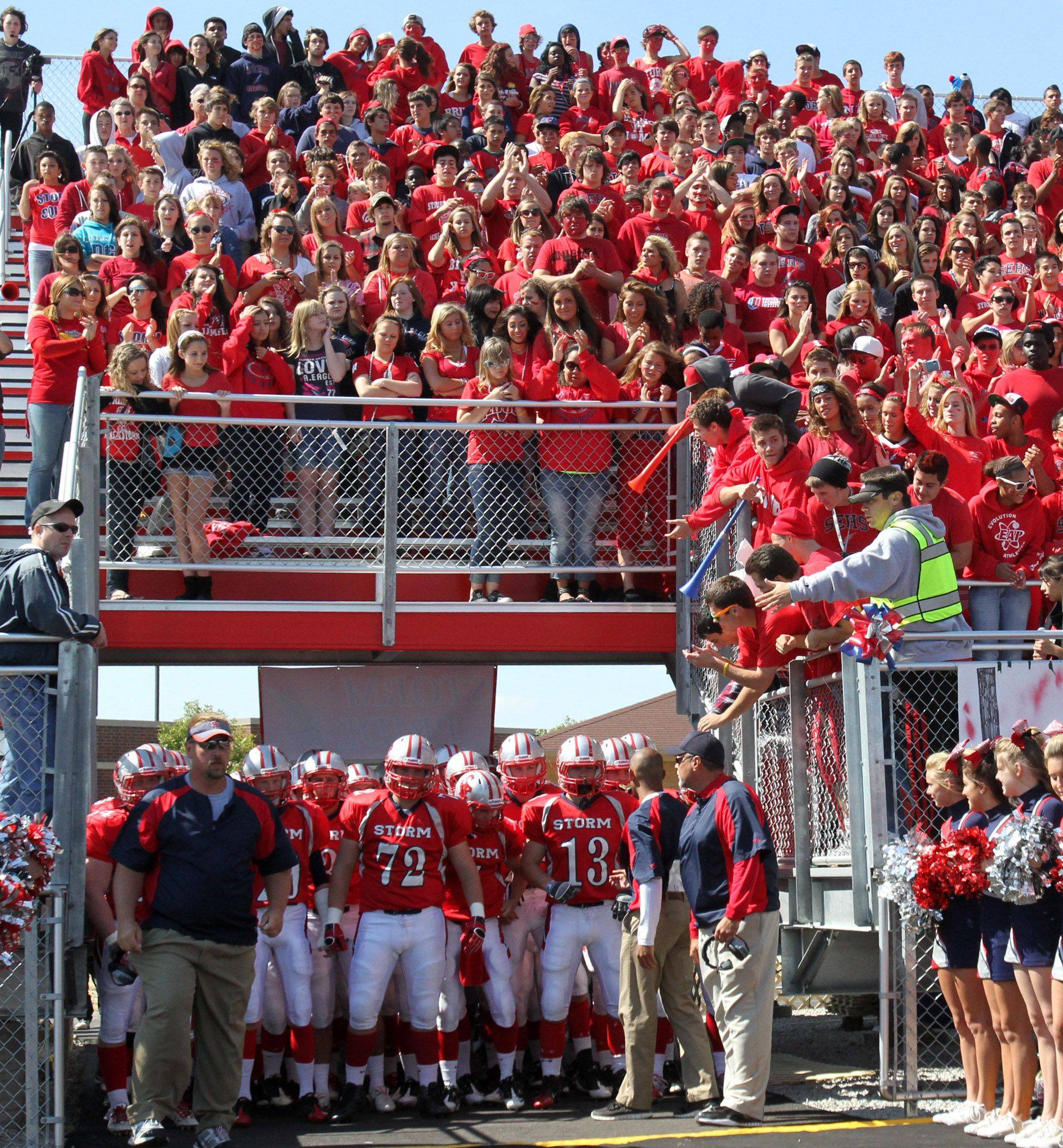 South Elgin's football team takes the field through the tunnel to play Metea Valley Saturday at the new South Elgin Stadium.