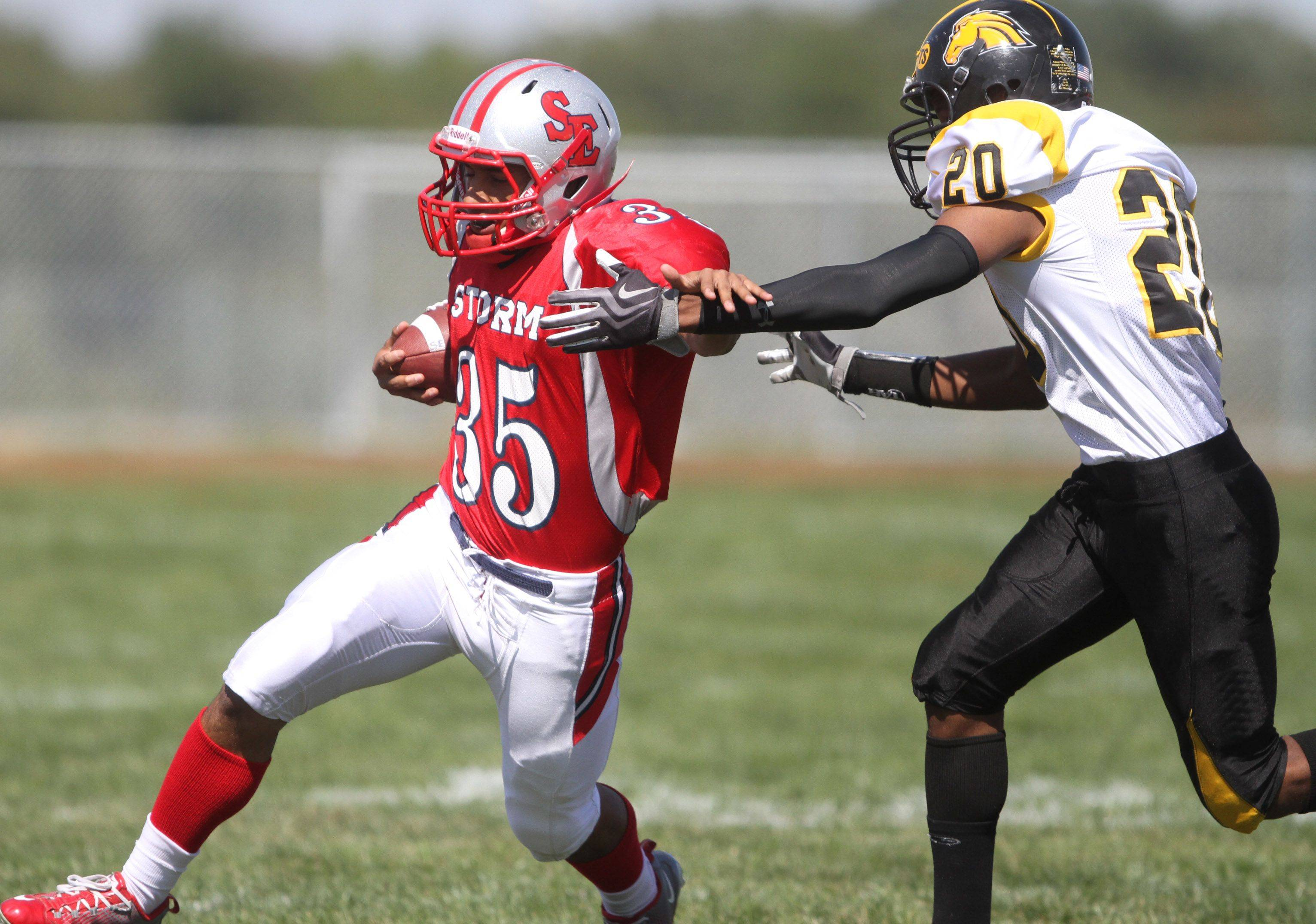 South Elgin's Adolfo Pacheco brushes off Metea Valley defender Breon Hoosier at South Elgin on Saturday, September 17th.