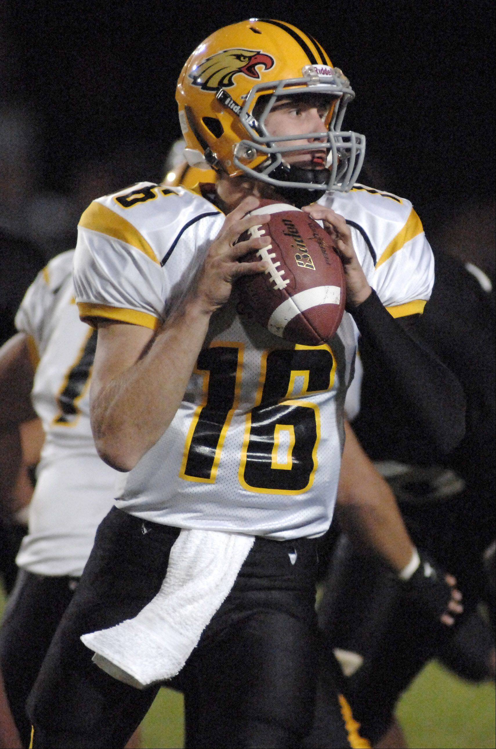 Jacobs' quarterback Jason Judson looks to pass in the first quarter vs McHenry Friday, September 16.