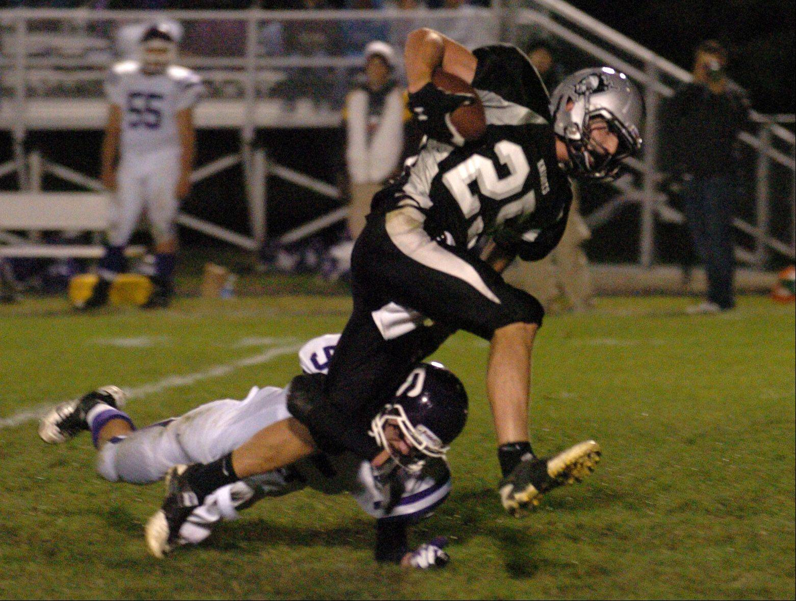 Kaneland's Sean Carter breaks a Rochelle defenders tackle Friday at Kaneland High School.