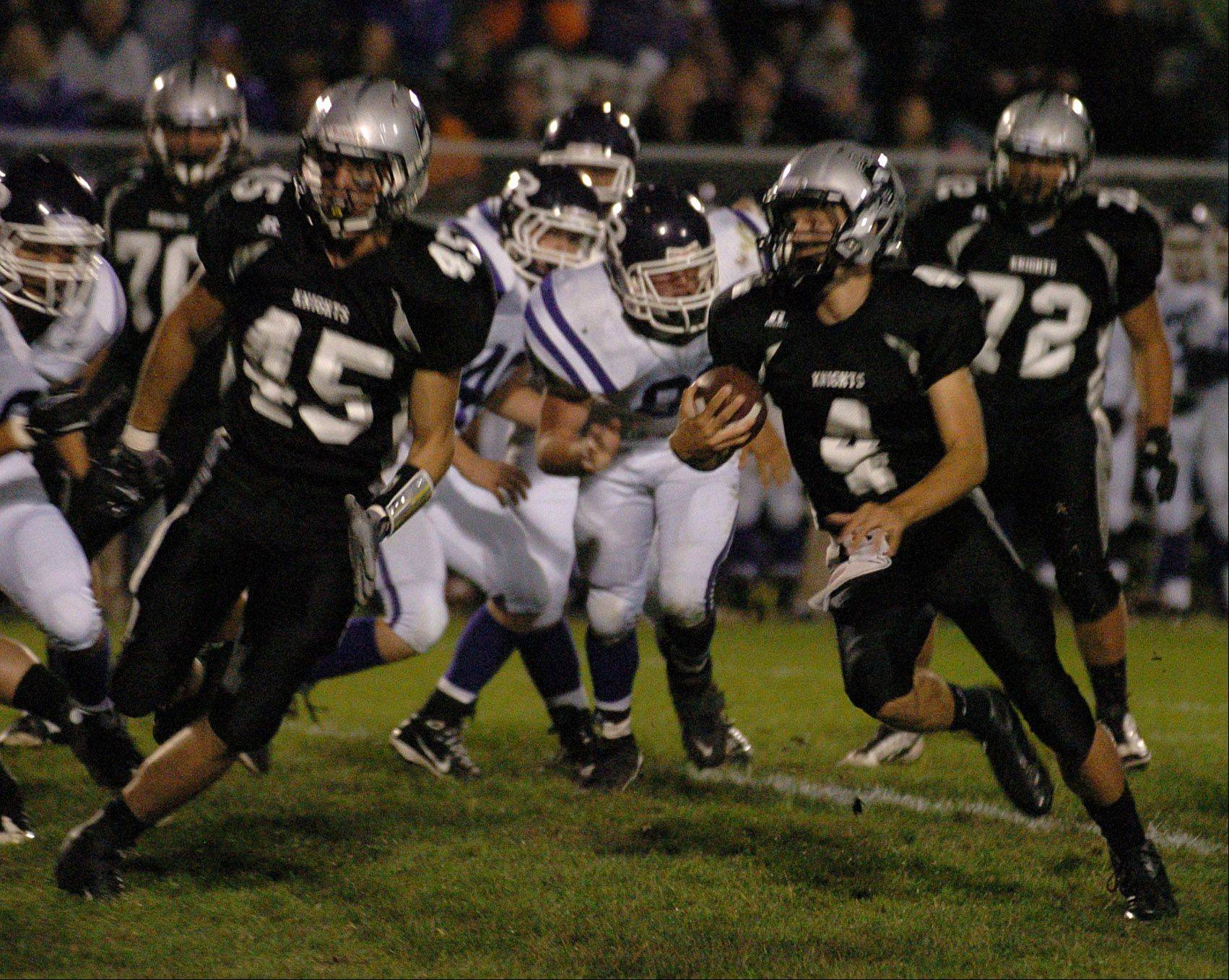 Kaneland quarterback Drew David escapes Rochelle's defense during Fridays game at Kaneland High School