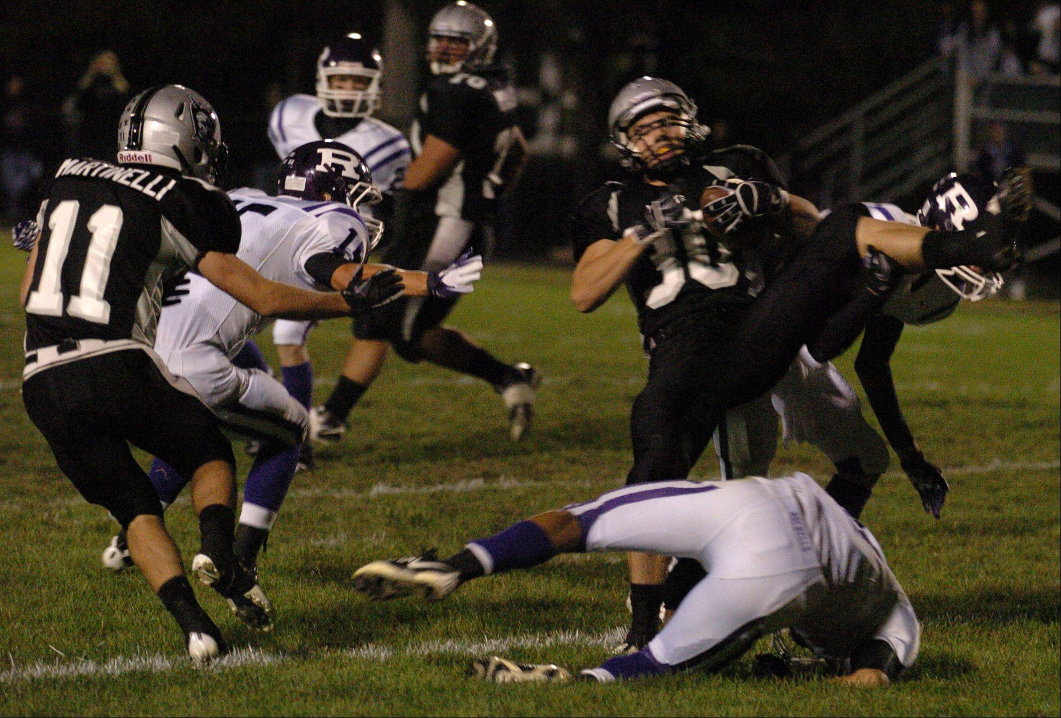 Kaneland's Jesse Balluff runs the ball through the Rochelle defense Friday at Kaneland High School.