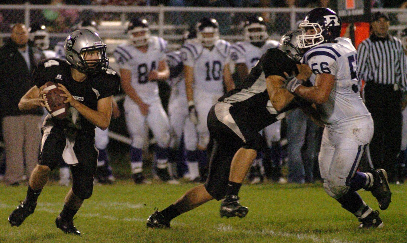 Kaneland quarterback Drew David threw for 260 yards and 3 touchdowns in the first half Friday against Rochelle.