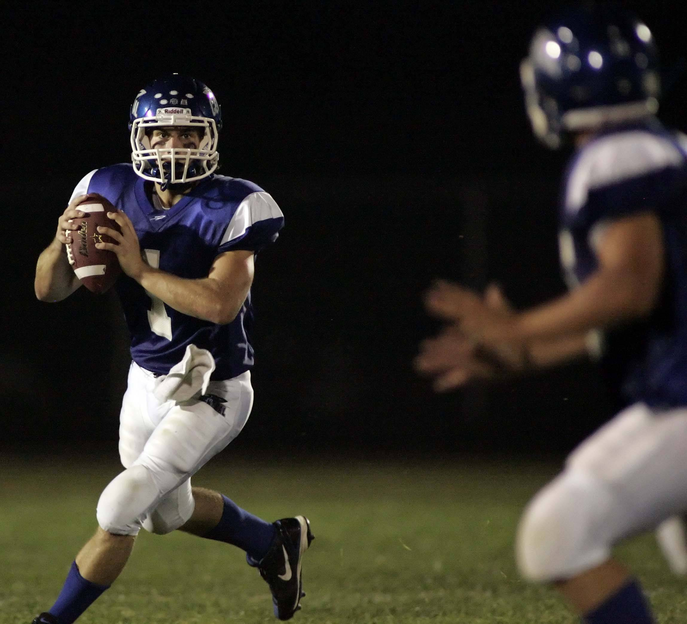 Burlington Central quarterback Ryan Ritchie looks upfield against Sycamore earlier this season. The Rockets (4-2) travel to undefeated Harvard tonight.