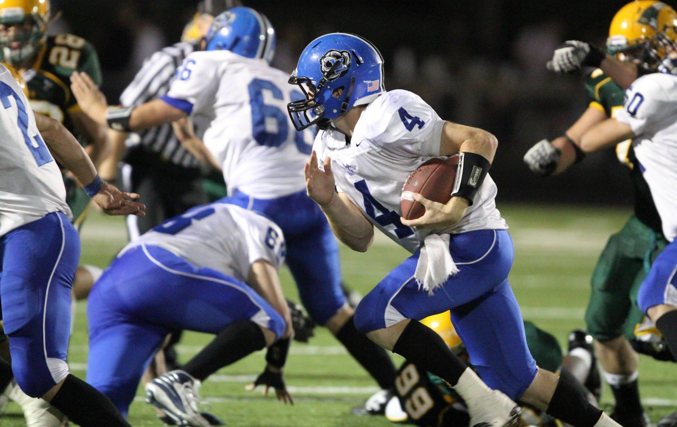 Lake Zurich's quarterback Zach Till runs the ball after faking a handoff at Stevenson on Thursday, October 6th.