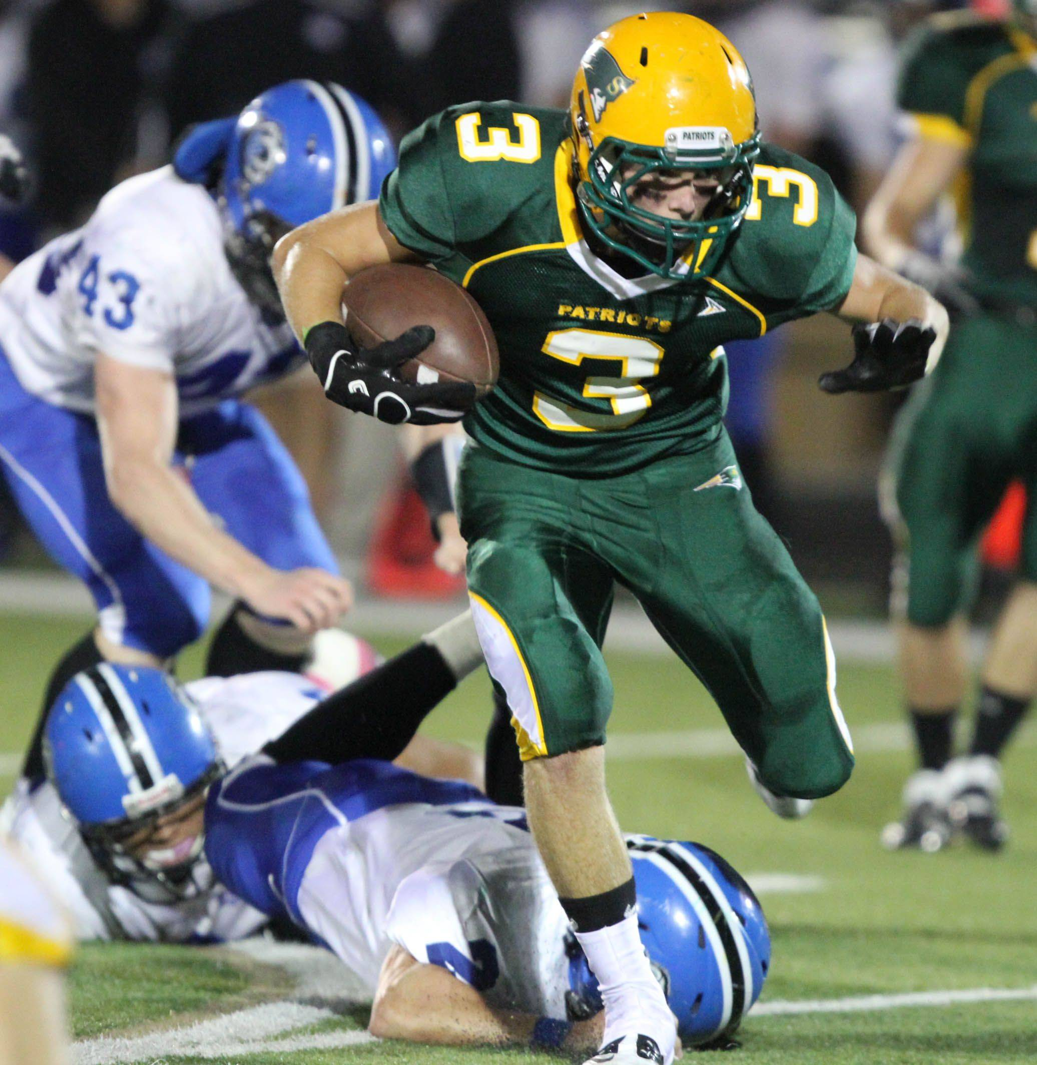 Stevenson's Anthony Bozin runs the ball in the first half against Lake Zurich at Stevenson on Thursday, October 6th.