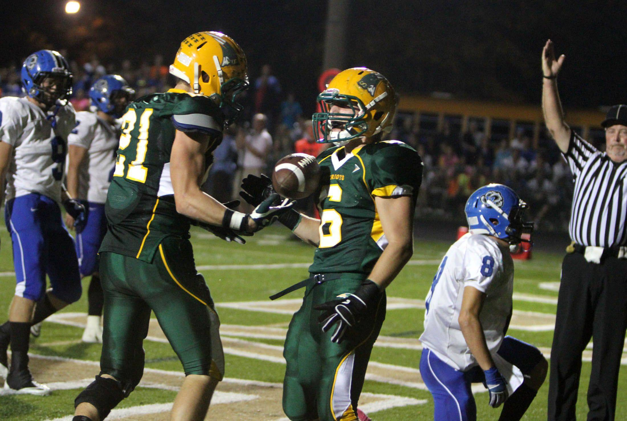 Stevenson's Jon Way, left, celebrates a touchdown catch with Nick Constantini against Lake Zurich making the score 13-0 in the first half at Stevenson on Thursday, October 6th.