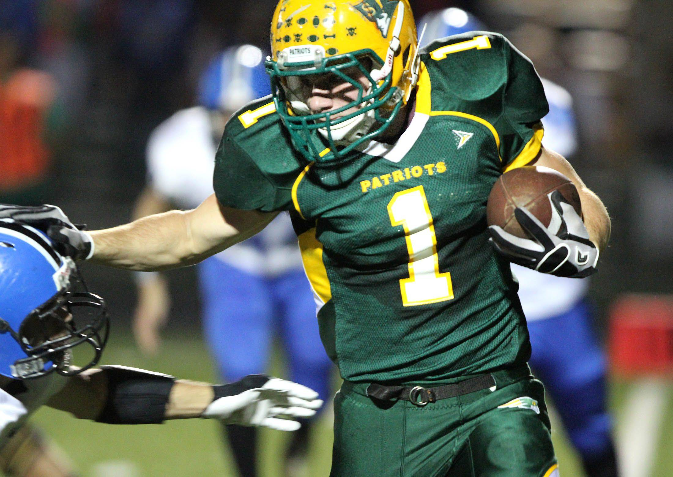 Stevenson's Kevin Foley runs the ball against Lake Zurich at Stevenson on Thursday, October 6th.