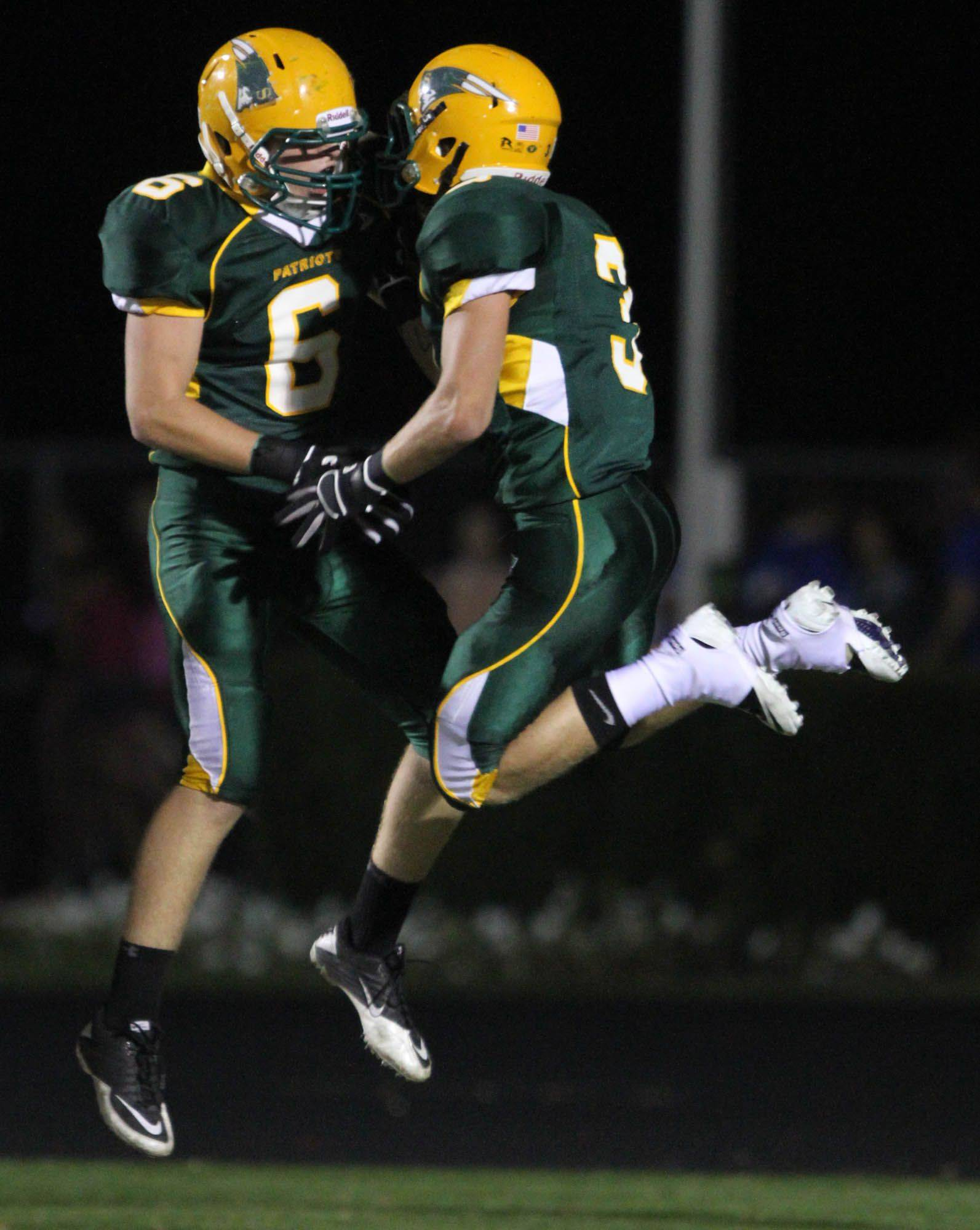 Stevenson's Anthony Bozin, right. leaps celebrating his touchdown catch with Nick Constantini against Lake Zurich at Stevenson on Thursday, October 6th.