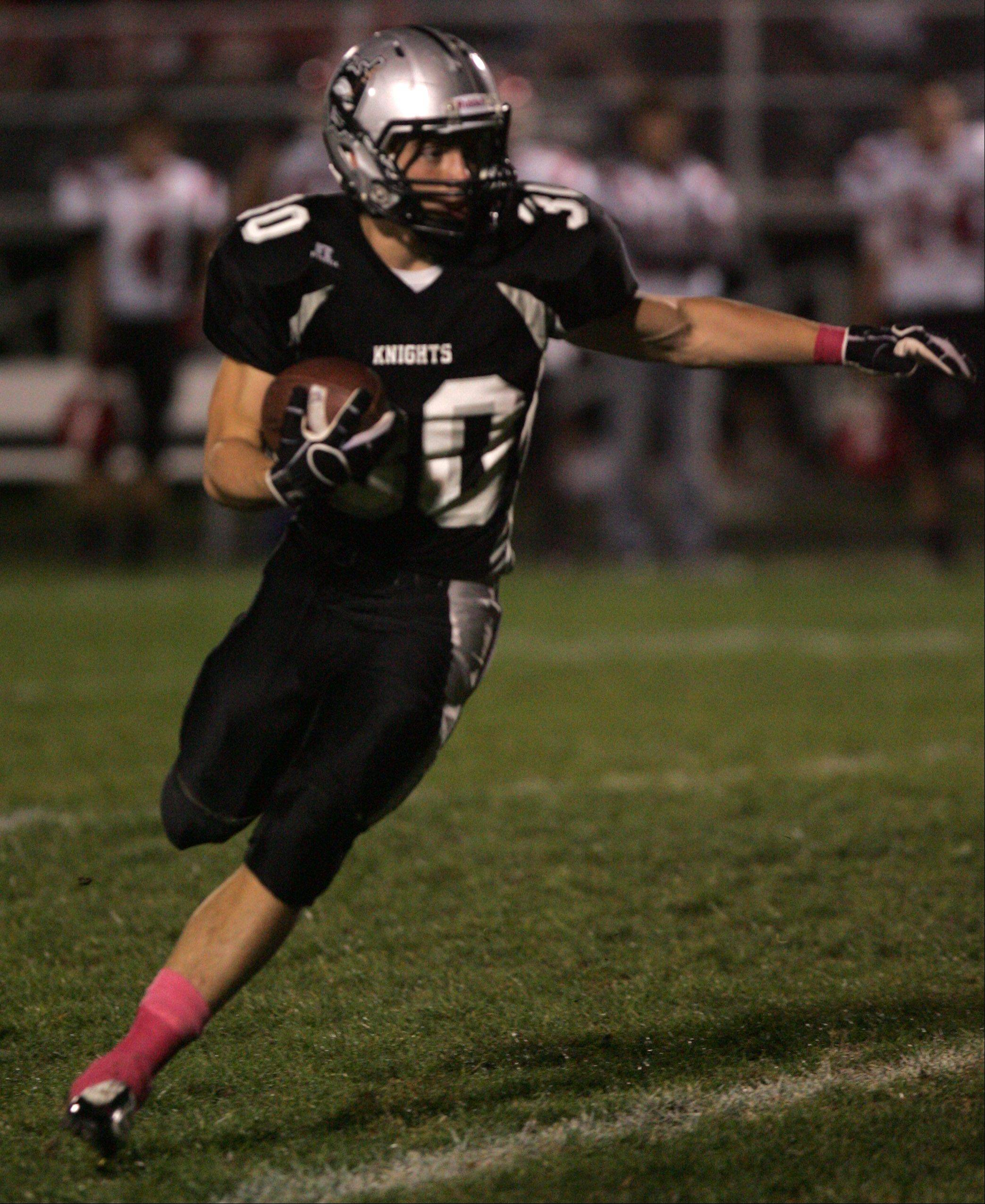 Kaneland's Jesse Balluff runs the ball against Yorkville during their game Friday in Maple Park.