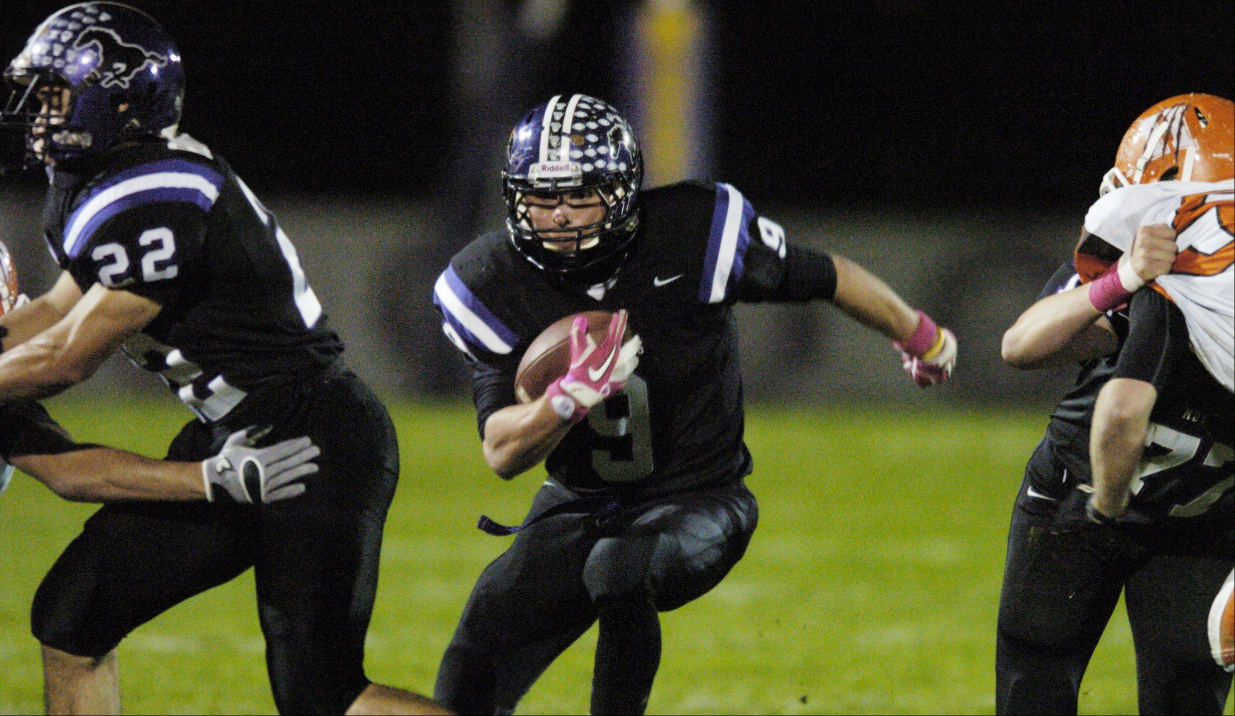 Week 9- Garrett Peterson carries the ball against Hersey.